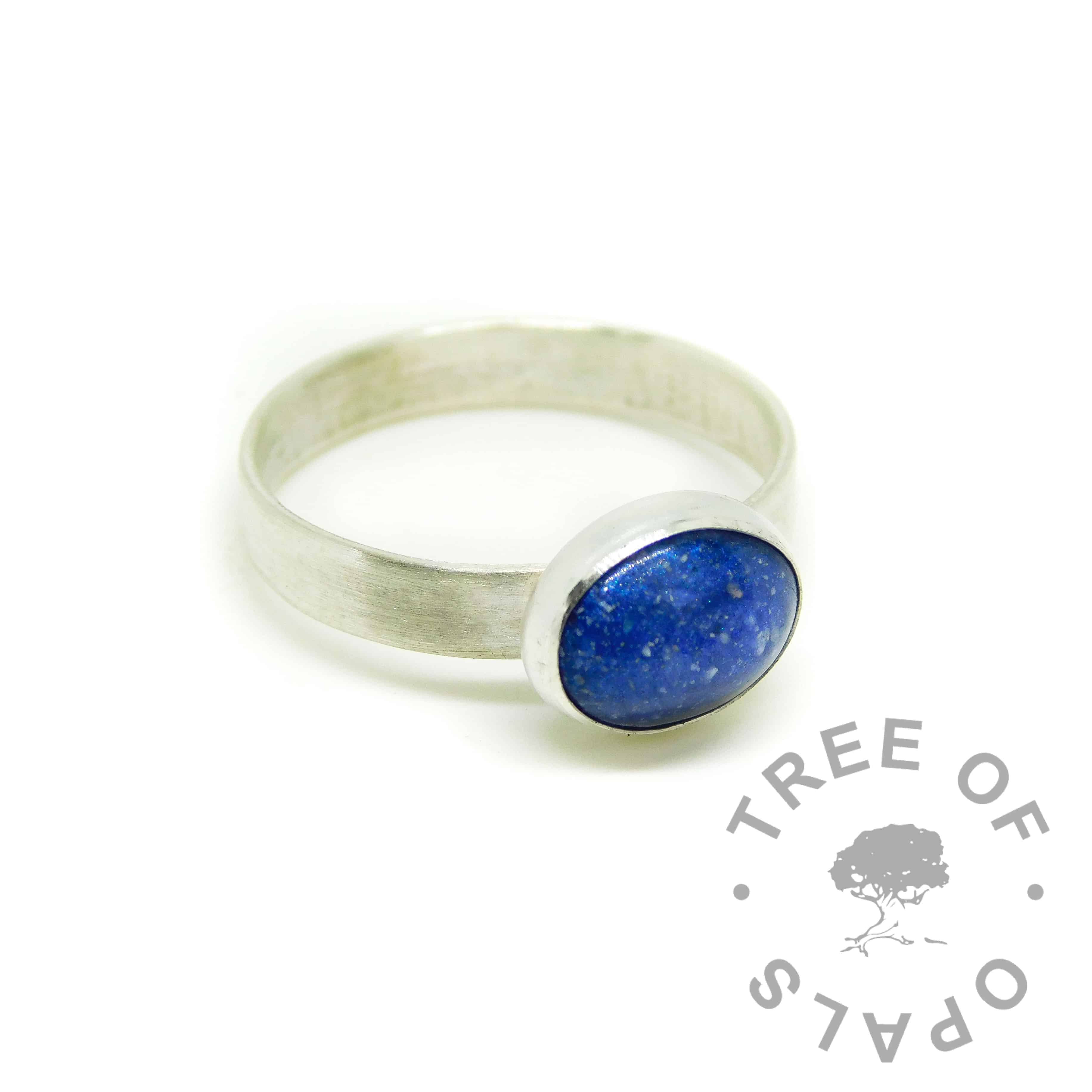Cremation ash ring with Aegean blue resin sparkle mix. Brushed band ring solid sterling EcoSilver