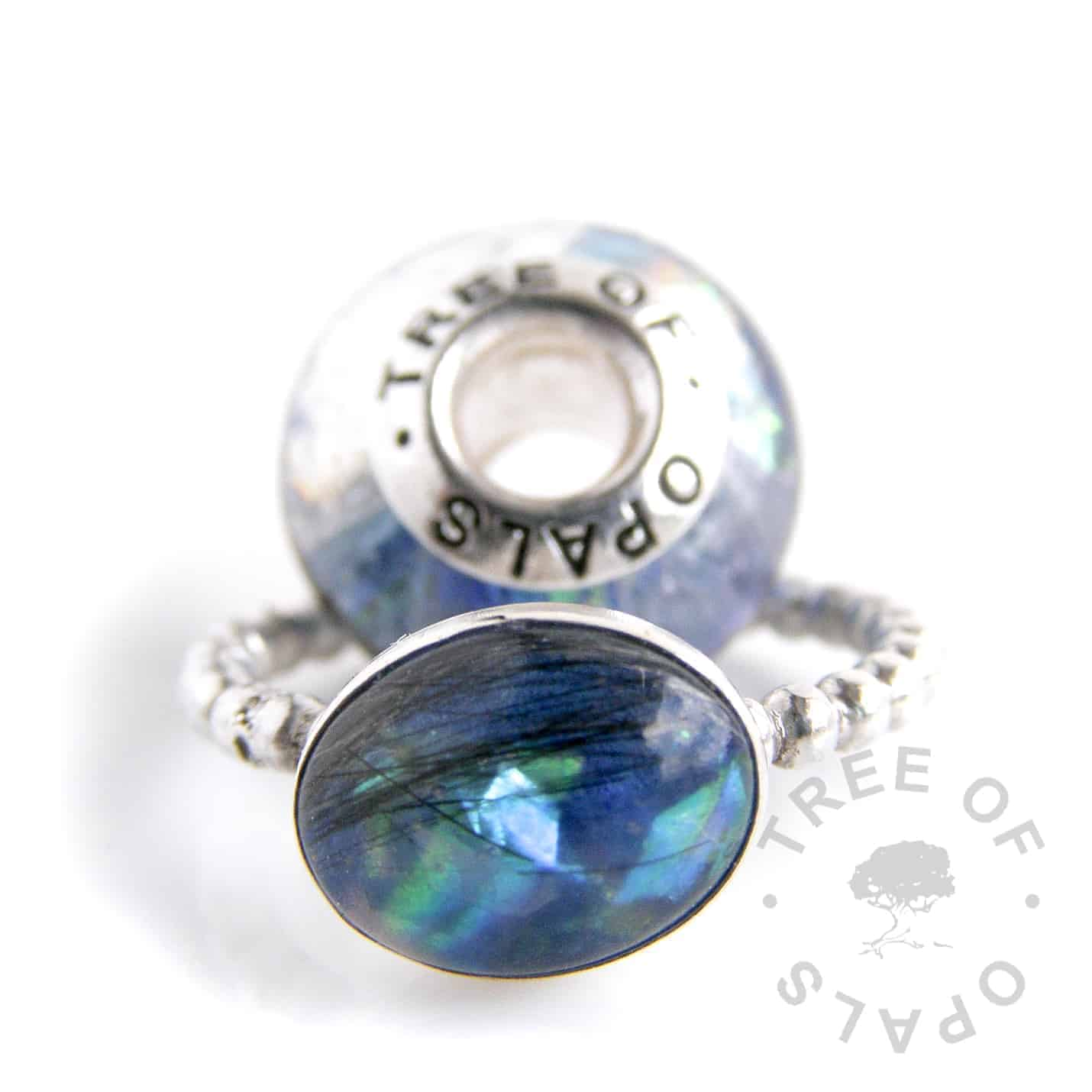 lock of hair family order lock of hair ring and charm bead with blue opalescent flakes, lock of hair charm bead blue opalescent flakes and Aegean blue shimmer core and solid sterling silver Tree of Opals signature core. Handmade with sterling silver by Tree of Opals