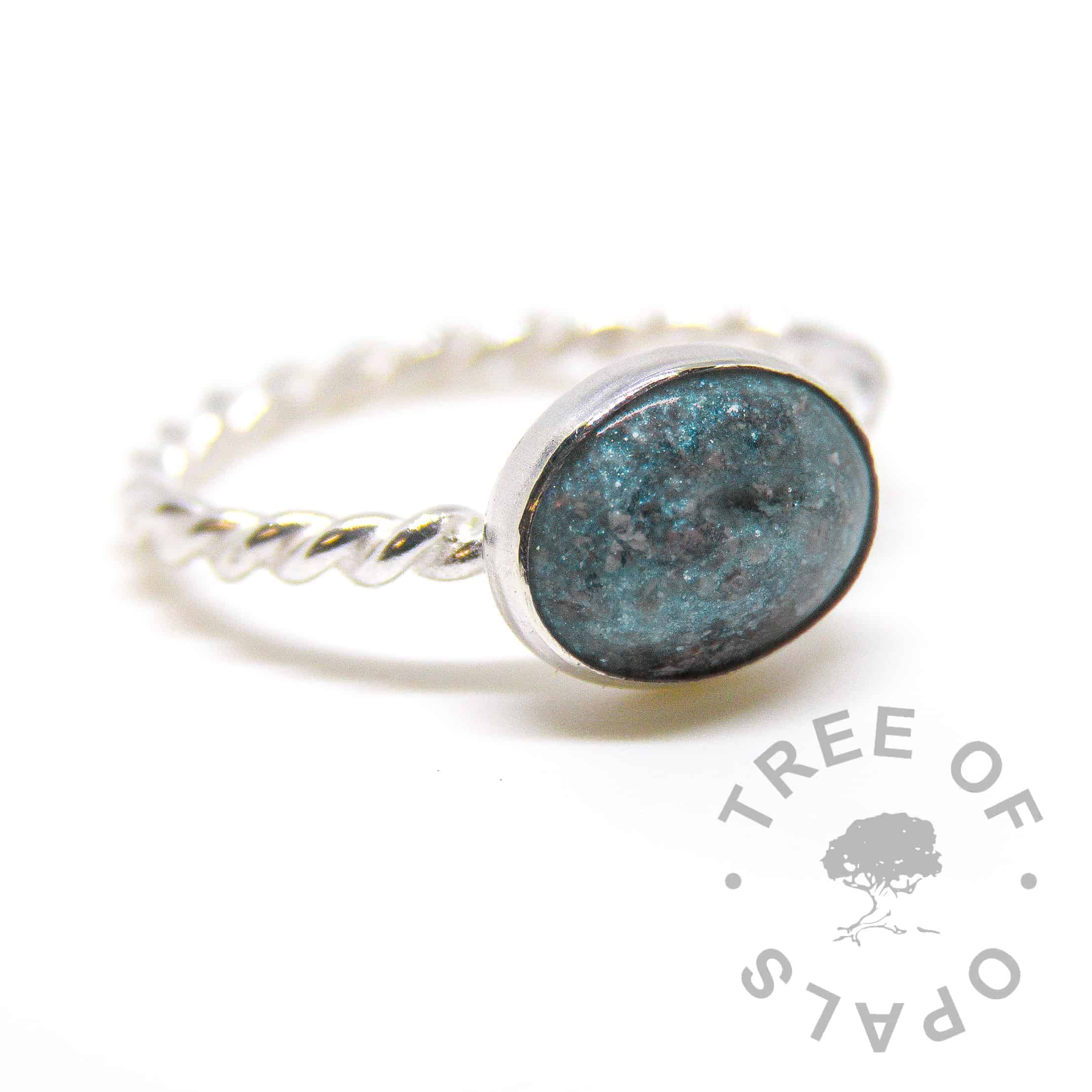 Cremation ash ring on twisted band with Aegean blue shimmer and cerulean blue glitter pro bono ashes memorial keepsake