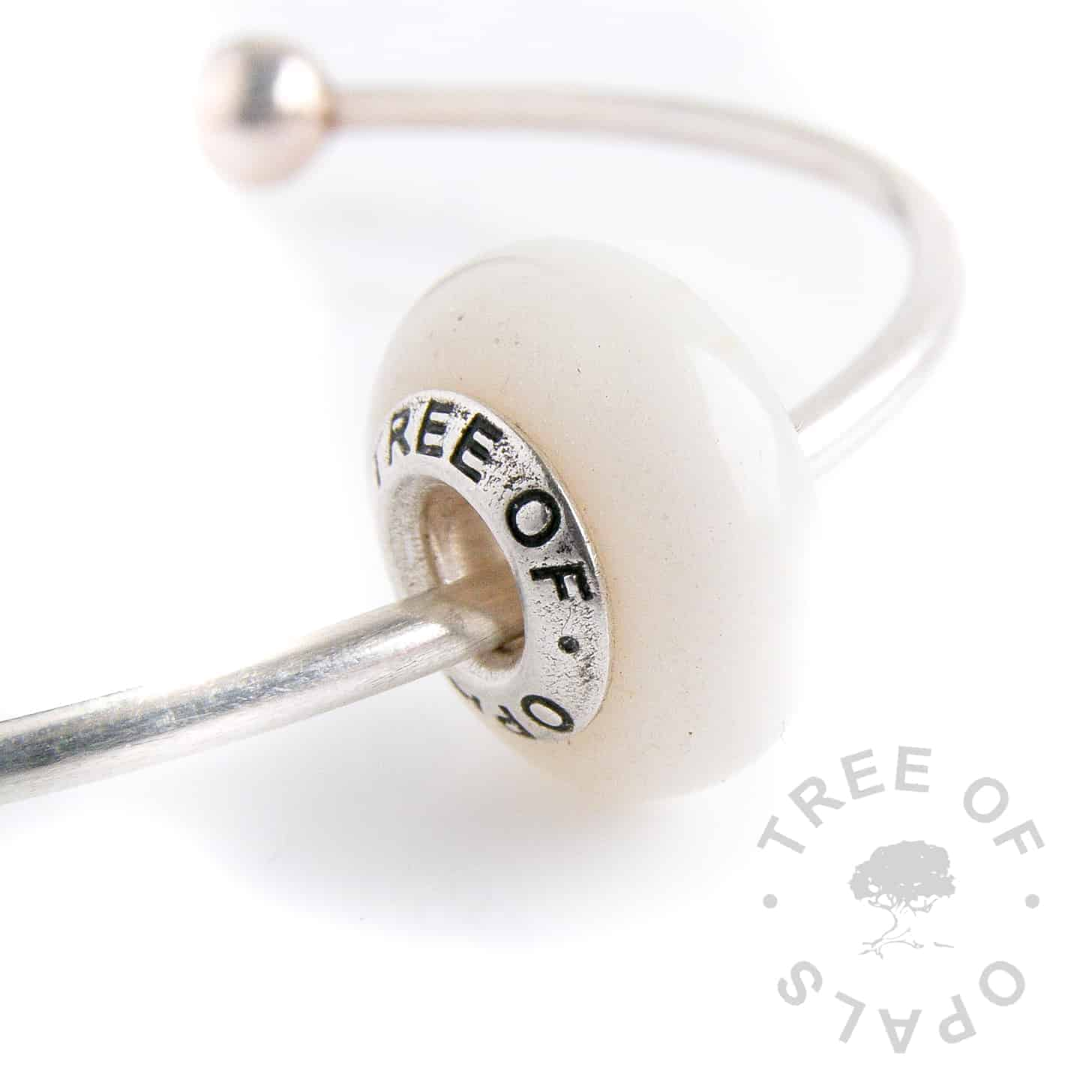 breastmilk charm bead with diamond powder for two year nursing award (diamond boobies) or the April birthstone for your baby.  Set with a solid sterling silver Tree of Opals signature core
