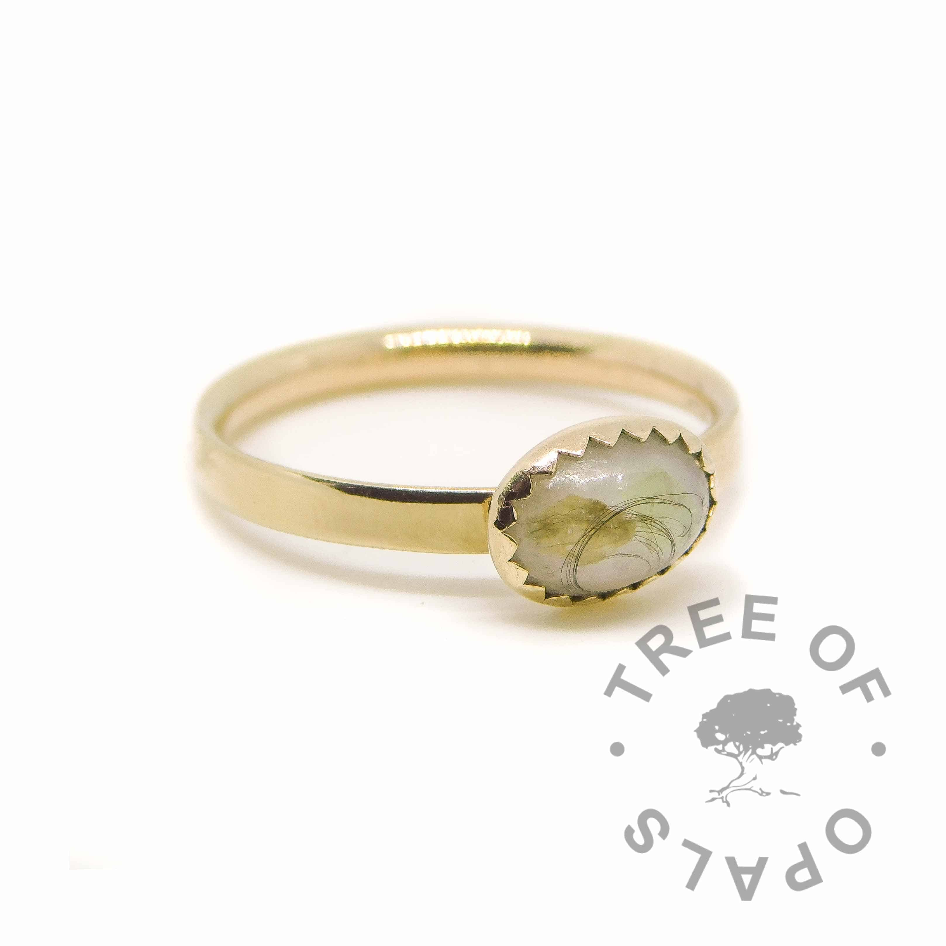 solid 14ct gold breastmilk ring with a lock of hair with vernix and rough August birthstone peridot