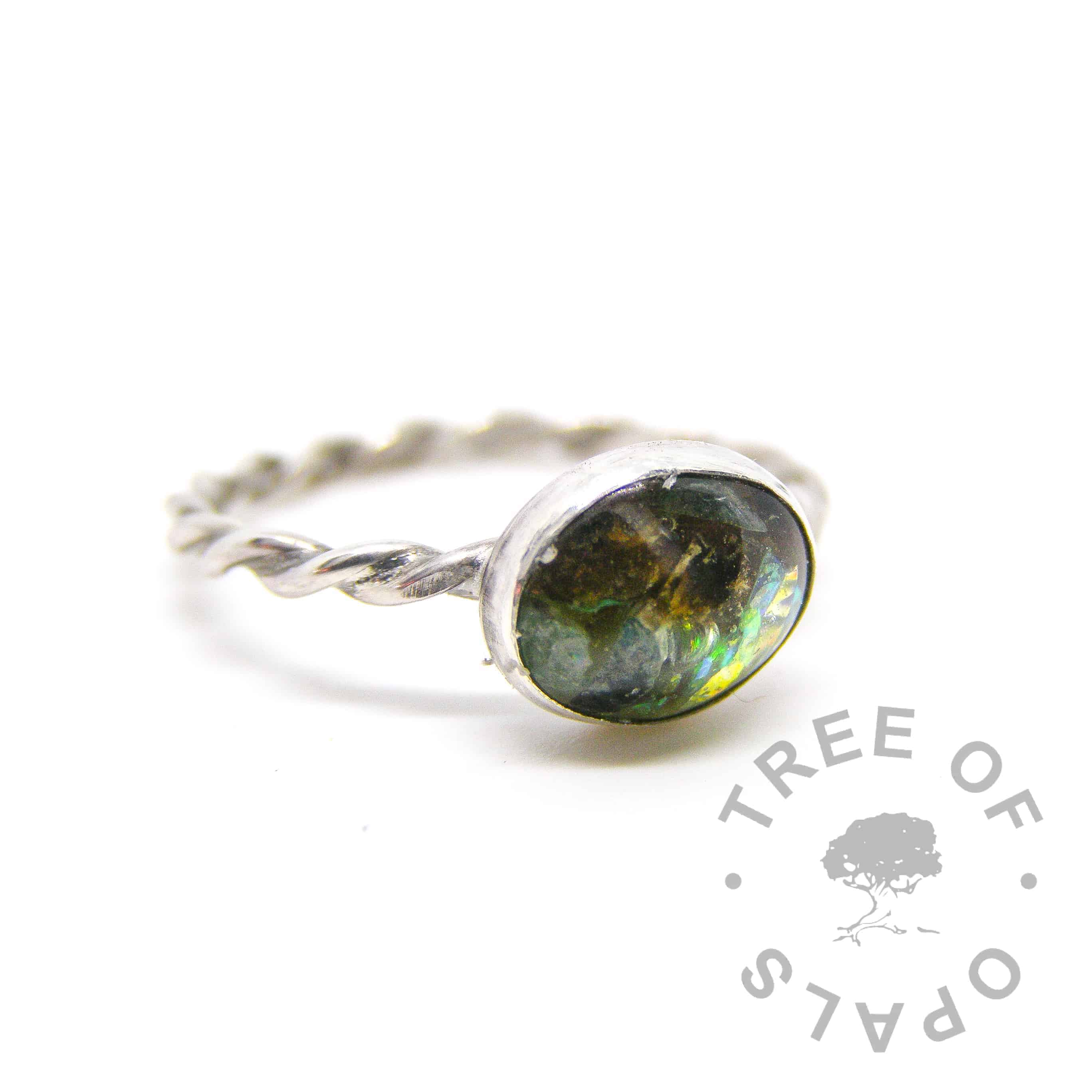 cremation ash ring with peridot and basilisk green colour mix on twisted wire band