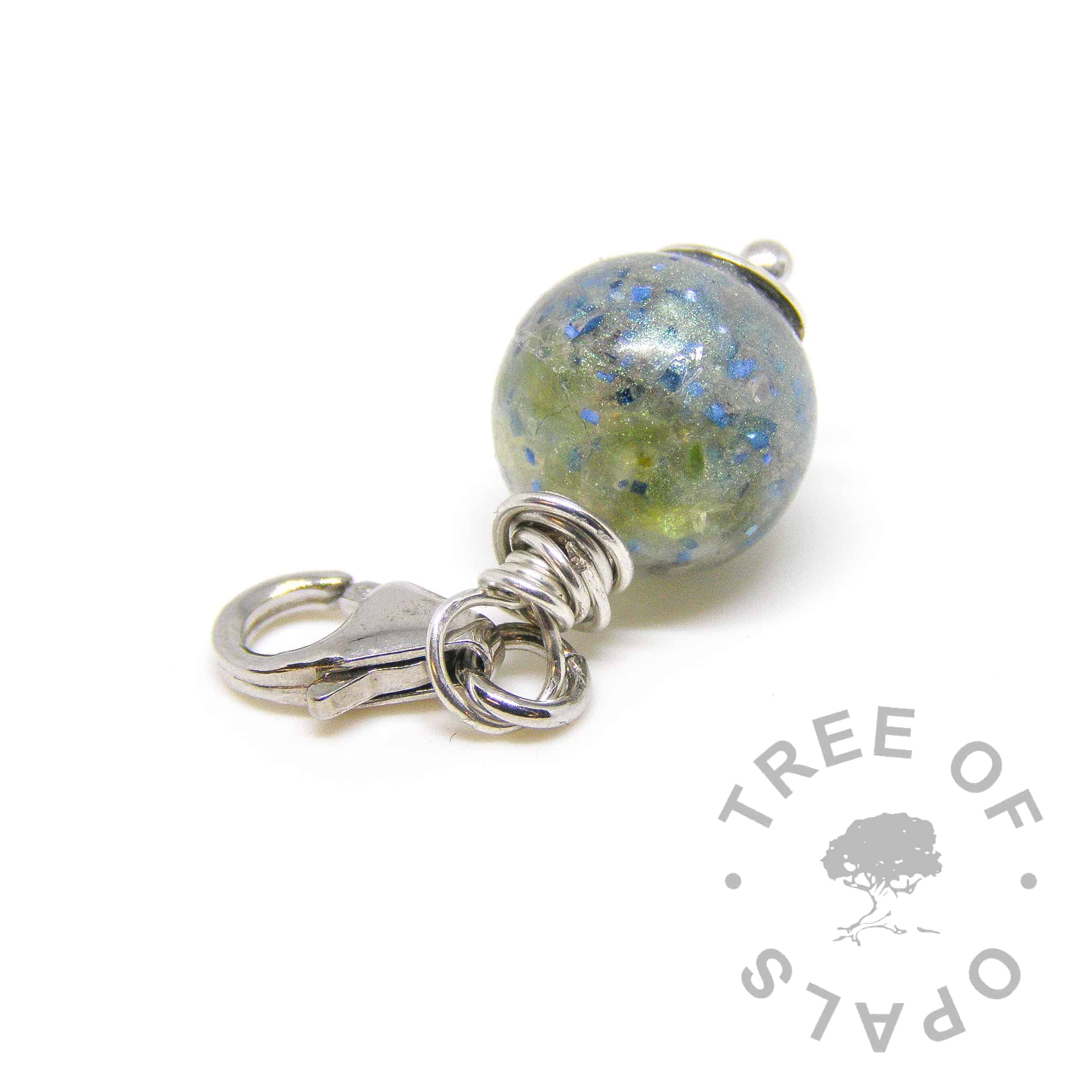 peridot cremation ash dangle charm, ashes pearl with peridot August birthstone and cobalt blue glitter, set with a lobster clasp ideal for large link bracelets and necklaces like the Thomas Sabo style