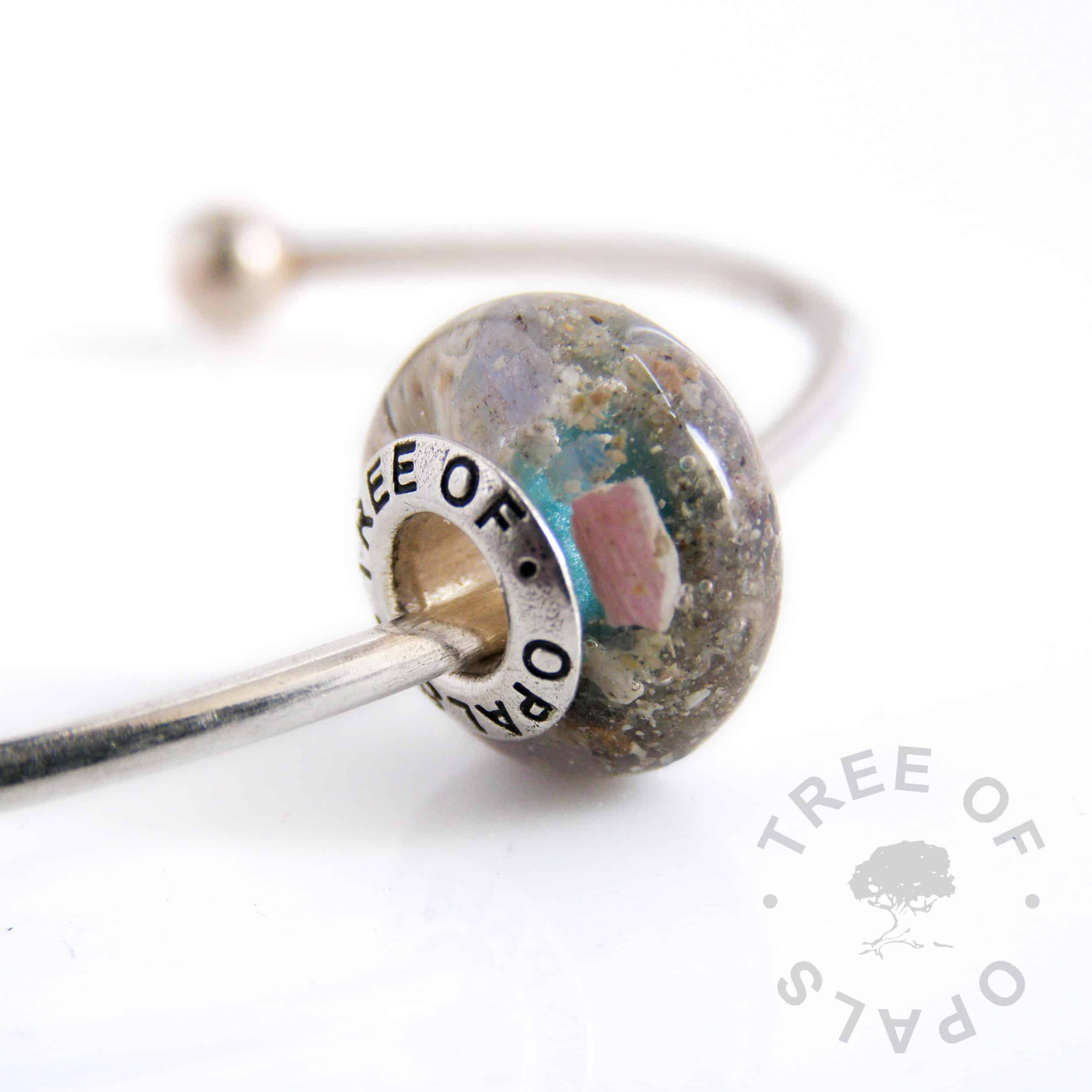cremation ash charm bead with crystal clear resin and tanzanite June birthstone sterling silver Tree of Opals solid core, teal shimmer painted core