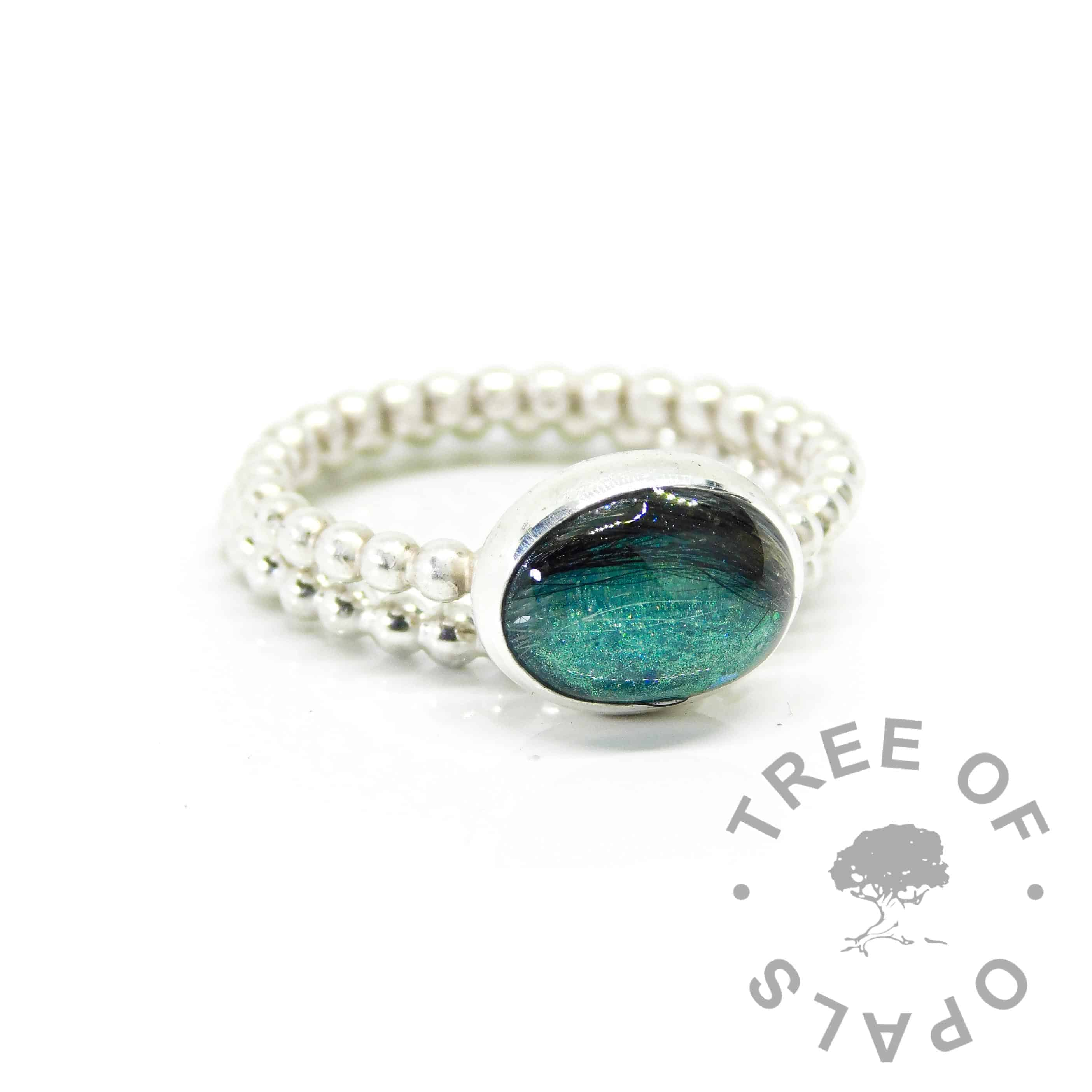 Hair ring on bubble band with mermaid teal resin sparkle mix, shown with bubble band stacking ring