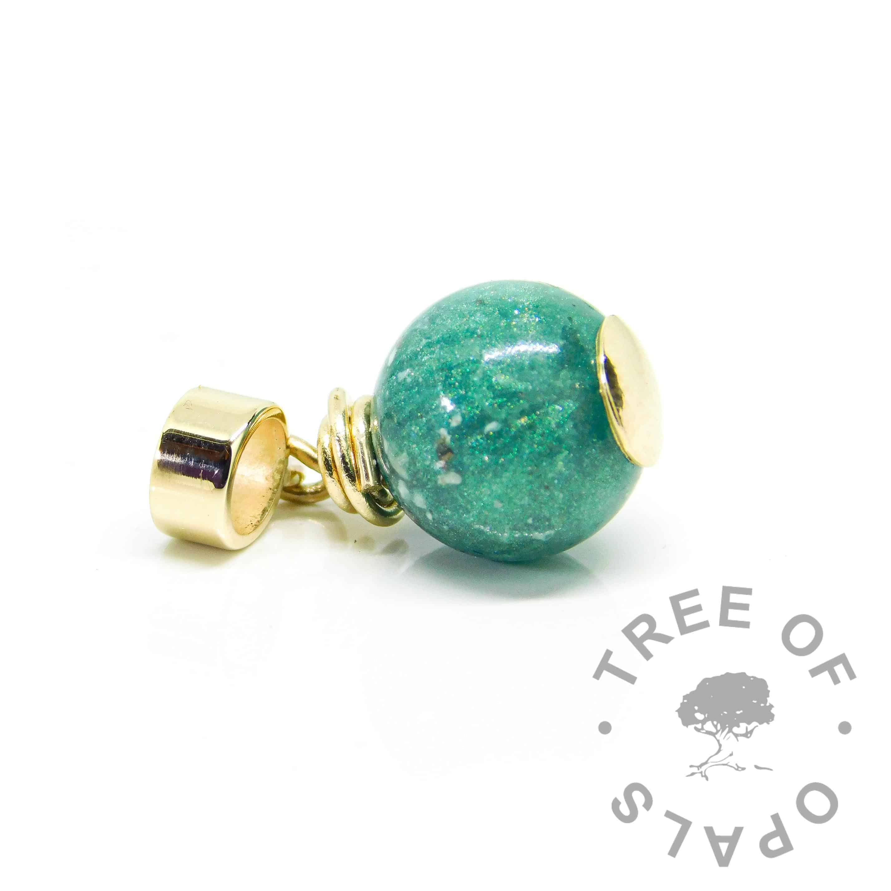 gold ashes orb teal. Mermaid teal resin sparkle mix with cremation ashes, solid 9ct gold wire wrapped setting with European dangle charm setting