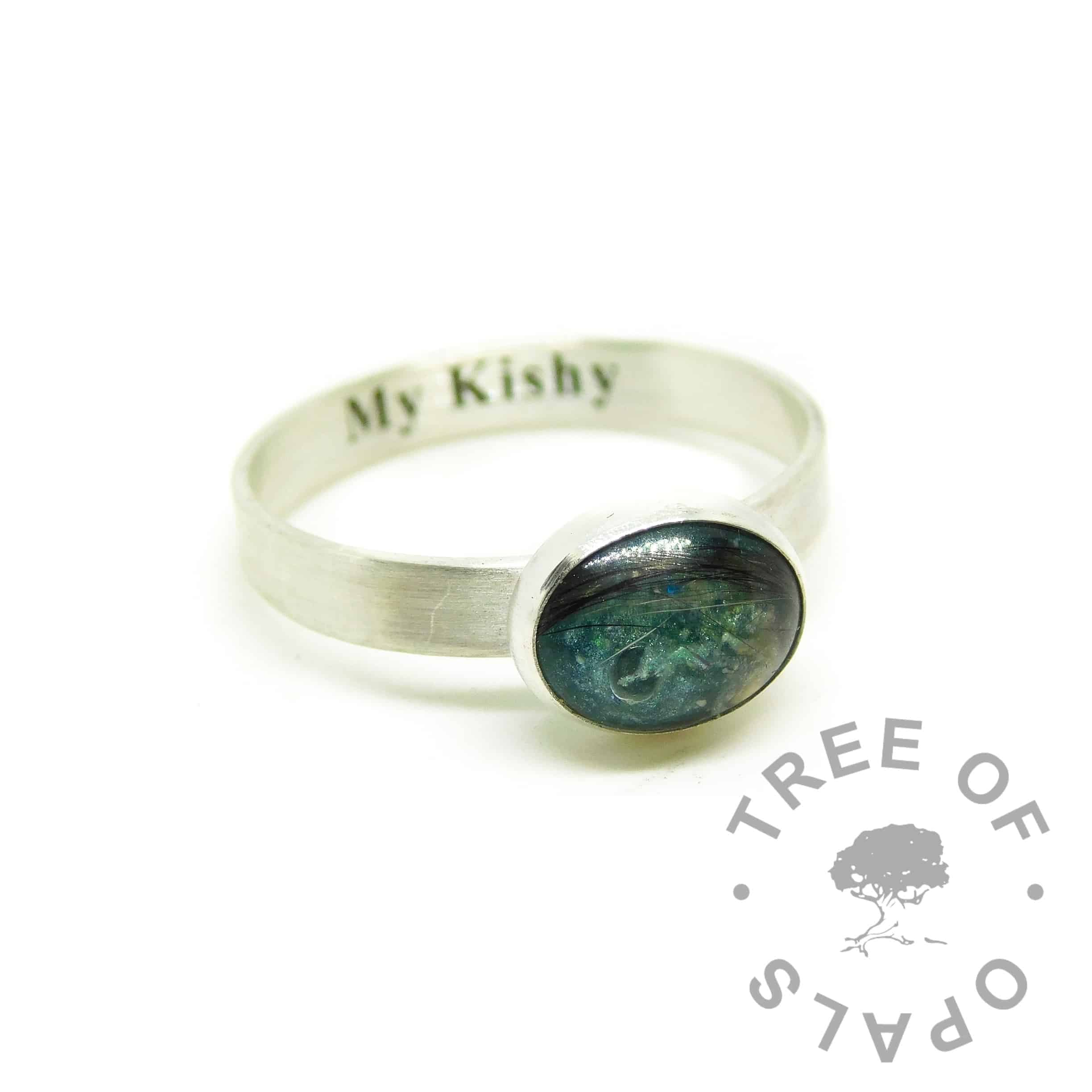 teal engraved fur ring, engraved with Times New Roman font on the inside of the band. Brushed band, mermaid teal resin sparkle mix