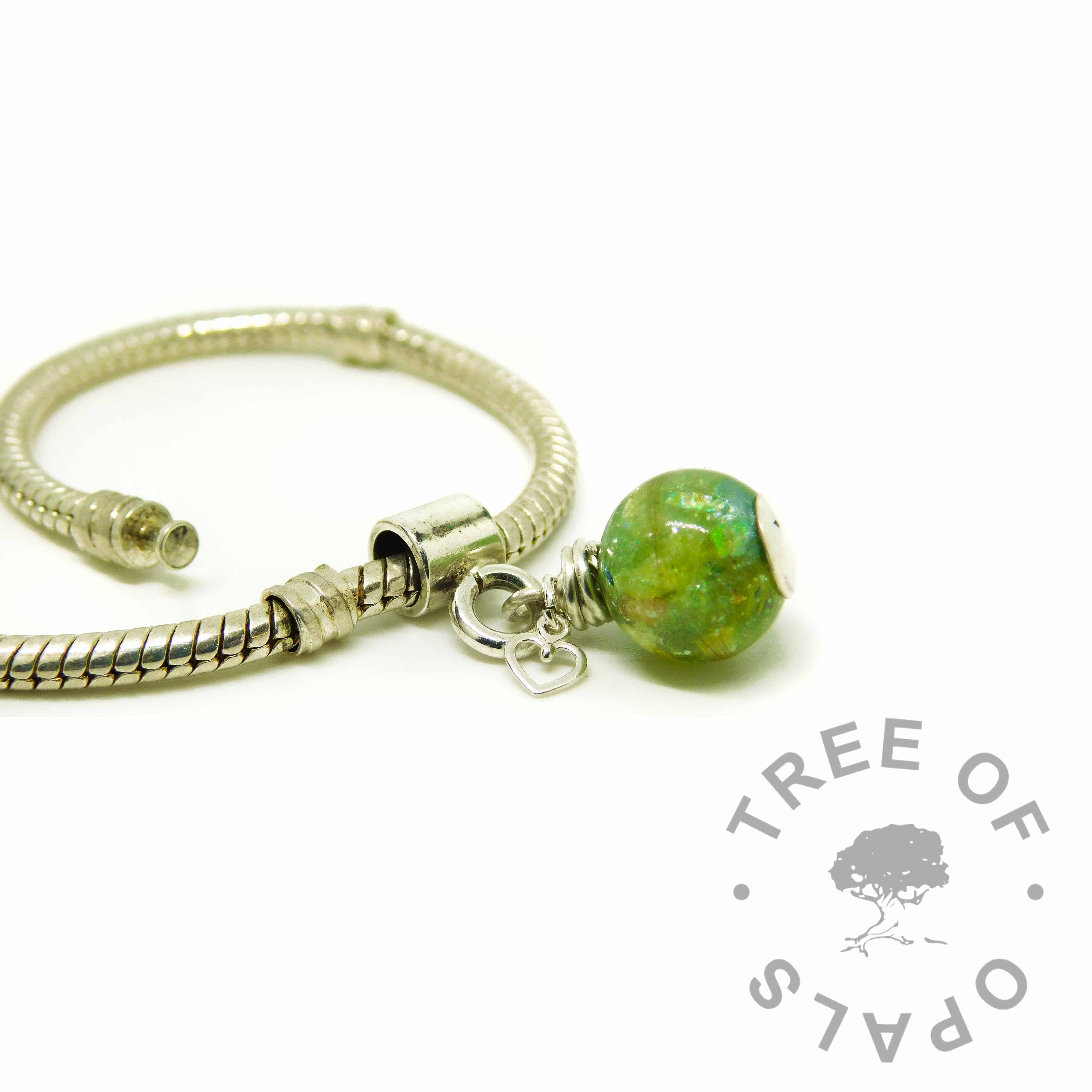 basilisk green lock of hair pearl with European charm setting for Pandora bracelets. Shown on a bracelet
