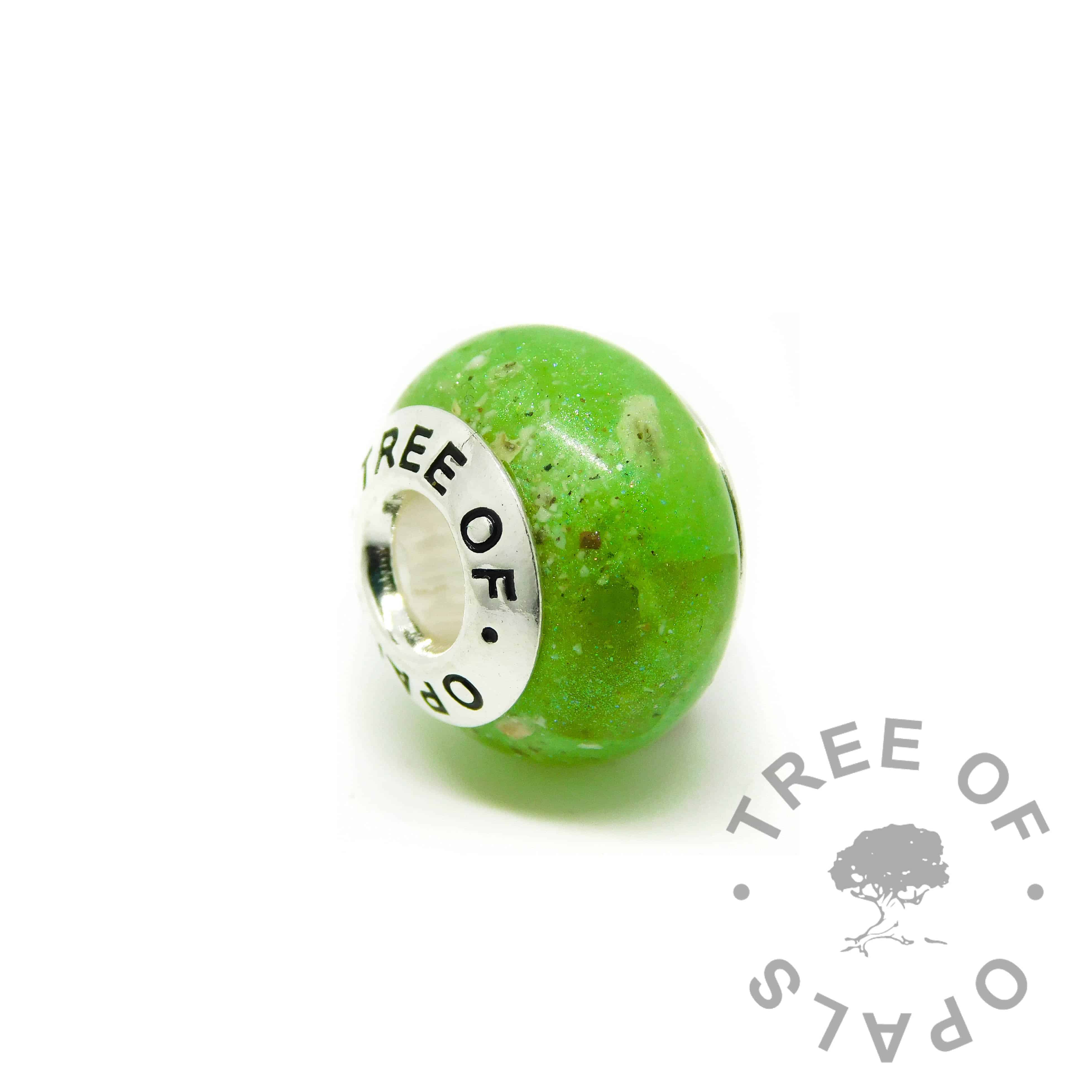 cremation ash charm basilisk green resin sparkle mix. ashes charms with solid silver cores