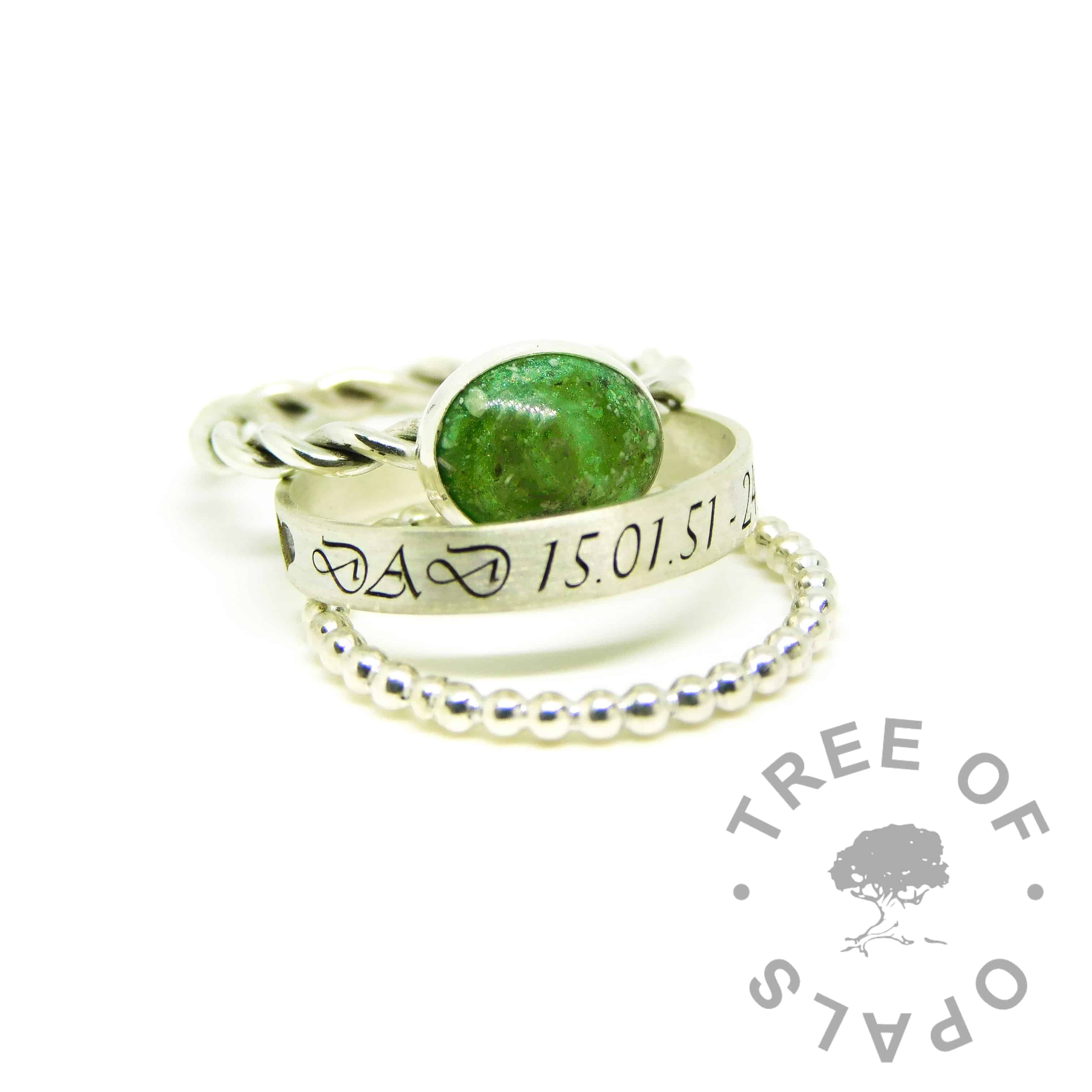 ashes jewellery rings, engraved 3mm brushed band with allcaps Vivaldi font on the outside of the band, bubble wire stacking ring, basilisk green resin ashes ring on twisted wire band