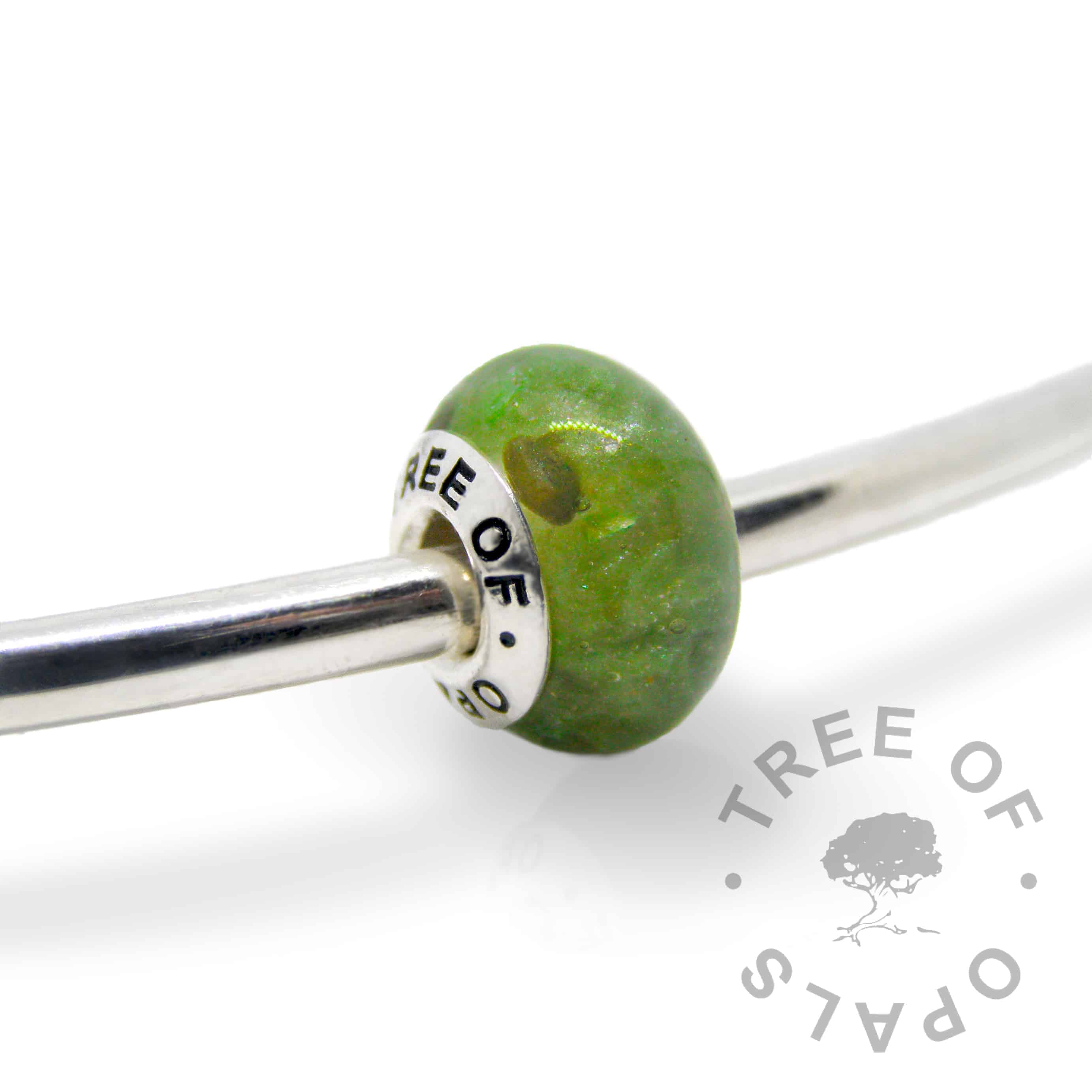 basilisk green cremation ash charm with solid sterling silver Tree of Opals core