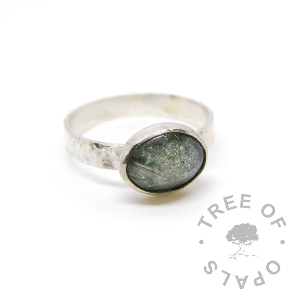 "memorial ring, grey hair and basilisk green sparkles on a textured 3mm wide solid sterling silver band and 10x8mm cabochon ""stone"""