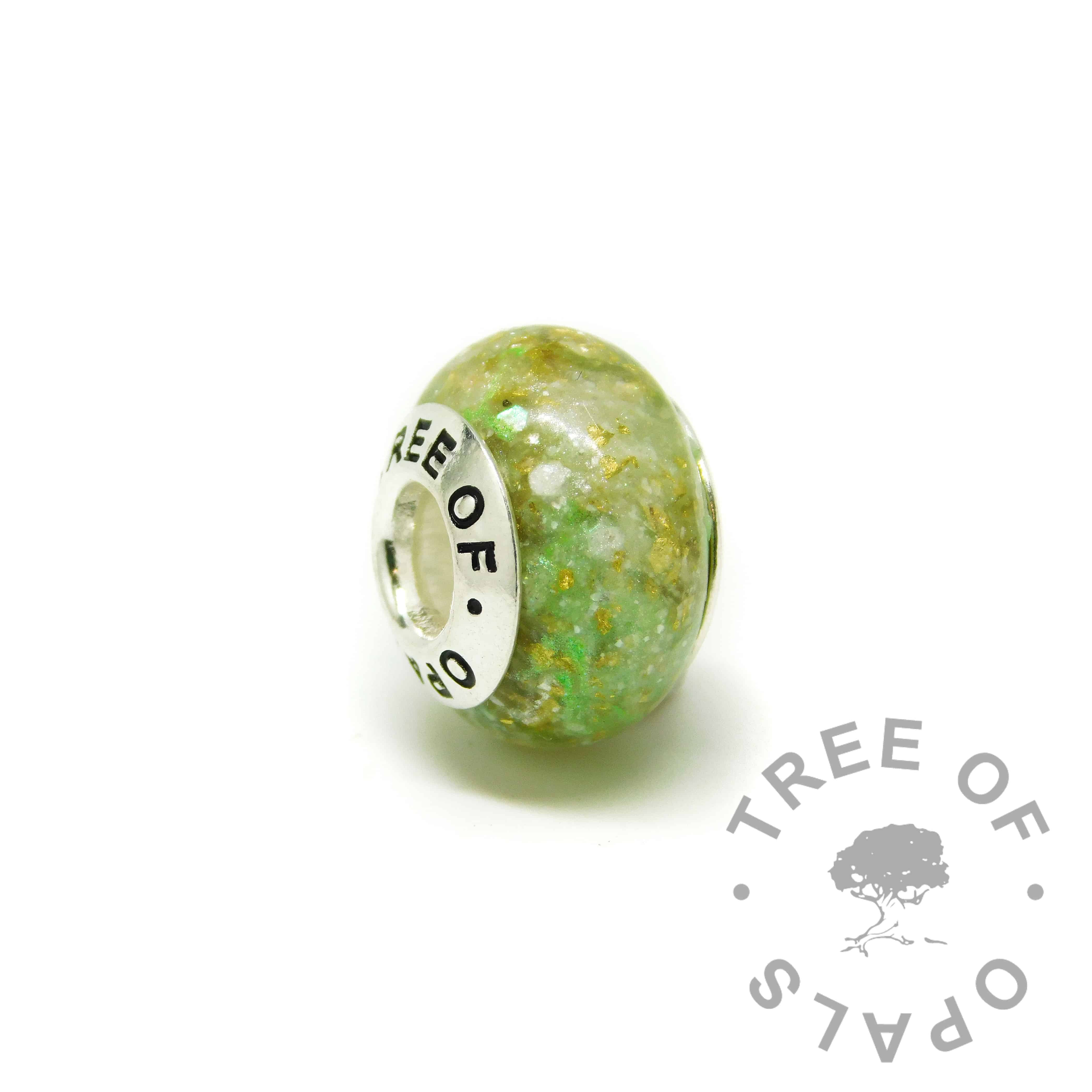 ashes charm with Tree of Opals core, basilisk green resin sparkle mix and subtle gold leaf. cremation ashes charm bead