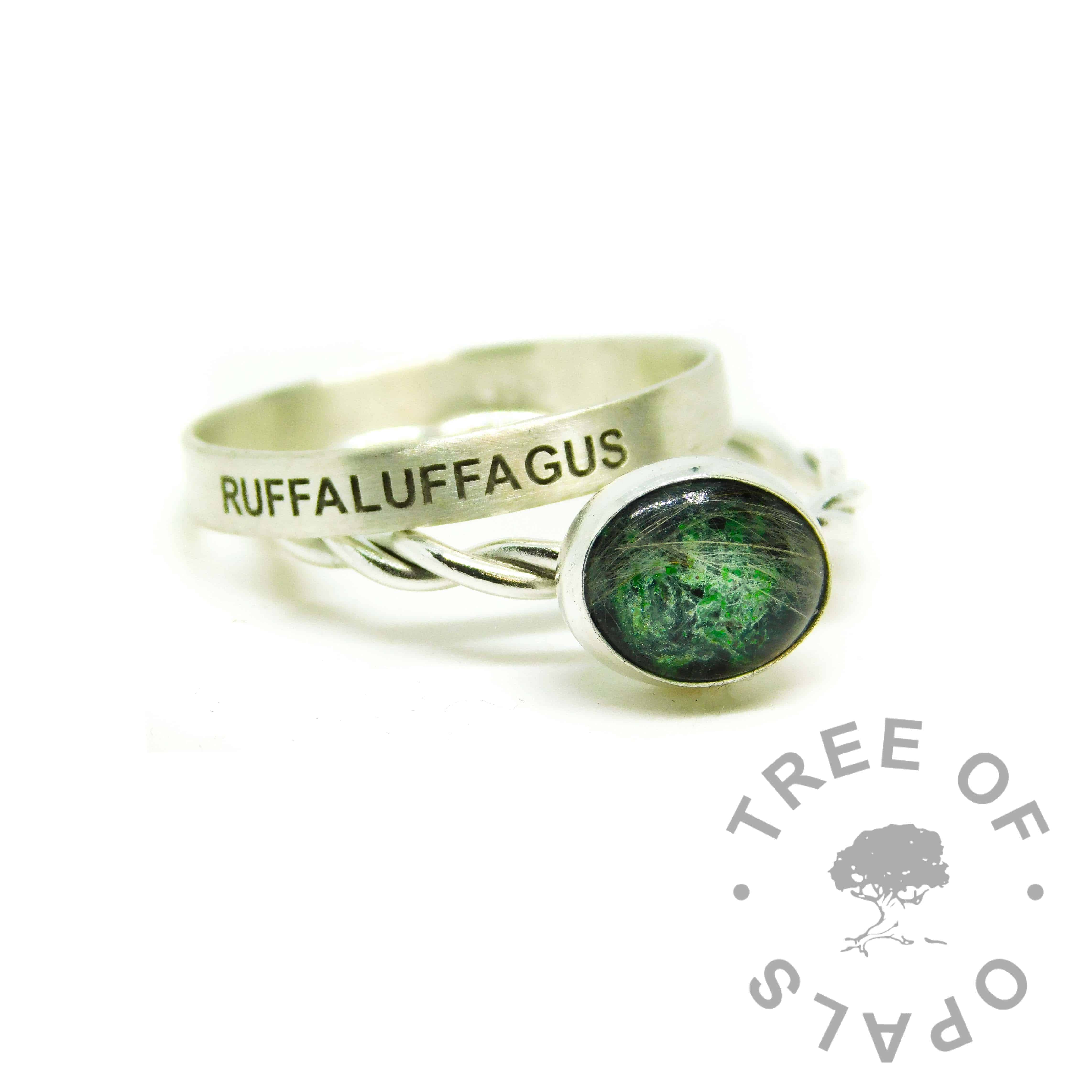 green ashes ring, cremation ashes ring on twisted band. Basilisk green resin sparkle mix. Shown with a brushed band wide stacking ring engraved in Arial font all-caps