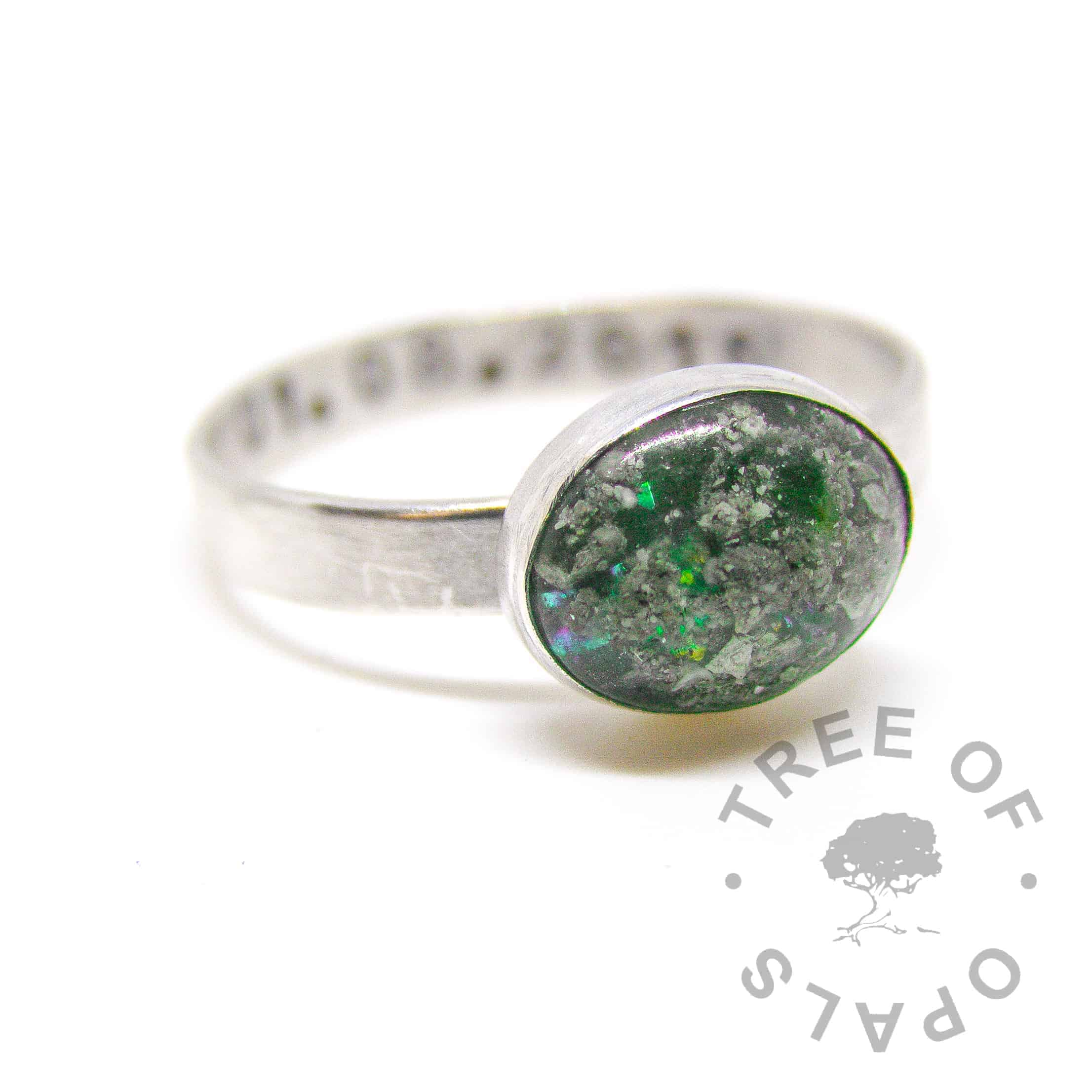 Emerald (May birthstone) ring with parakeet green glitter. Brushed band and date of birth stamping (mockup)