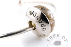 stamped washer in sterling silver on cremation ash charm bead with white gold leaf