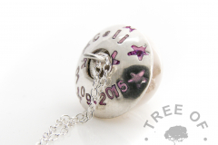 charm necklace and charm washer shown with a breastmilk charm bead, hand stamped with name and purple patina letters