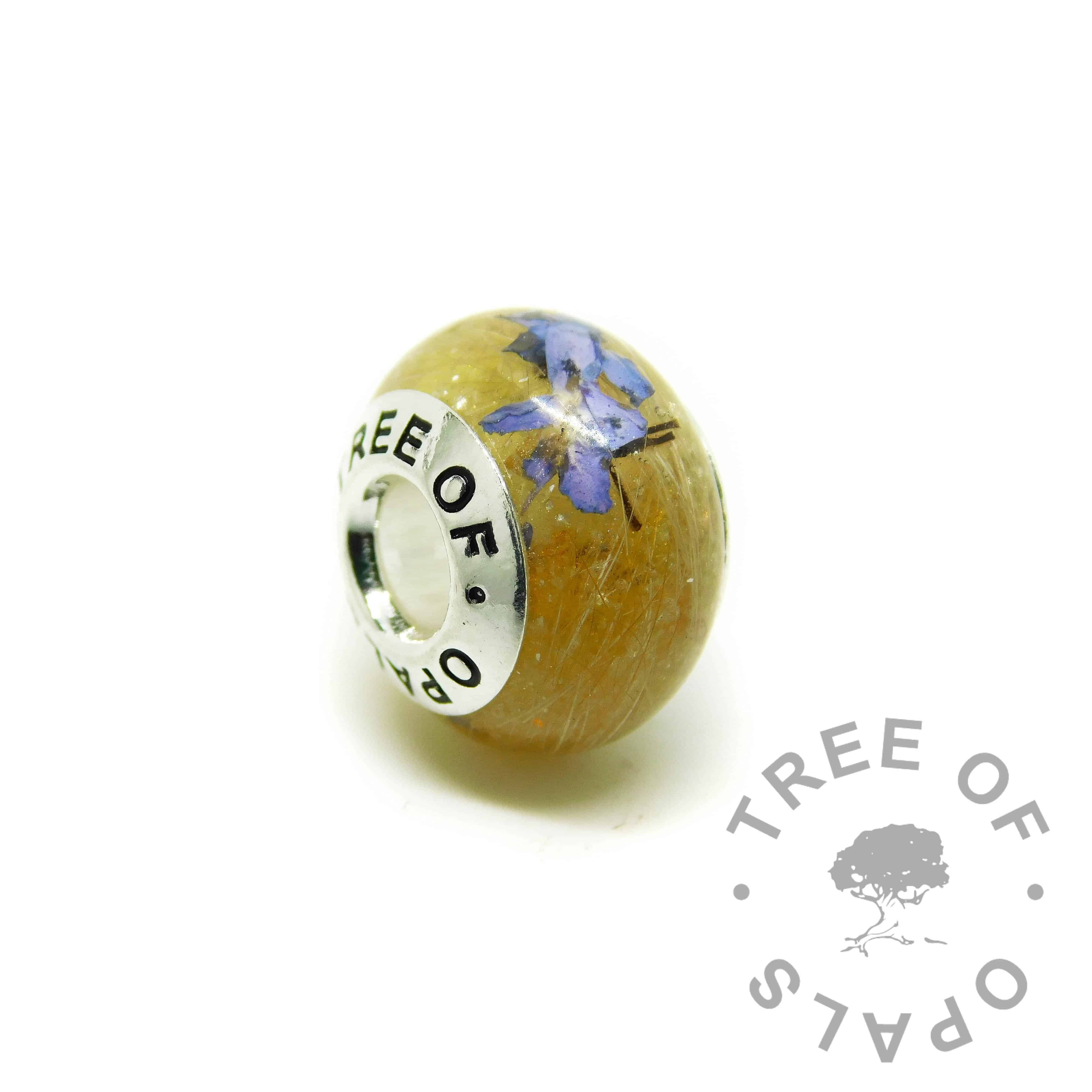 chimera yellow resin sparkle mix lock of hair charm. Forget-me-not flower addition and dog fur