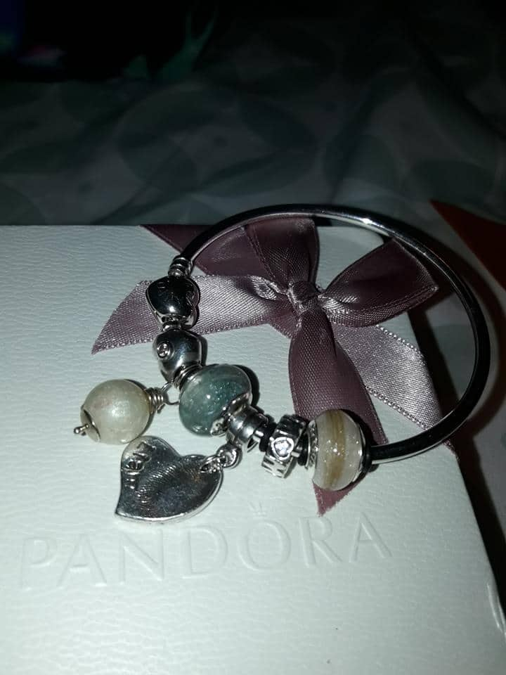 client's own jewellery photo, lock of hair charms on a Pandora bracelet