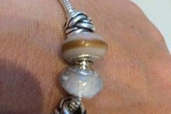 breastmilk and hair charm beads on client's Pandora bracelet