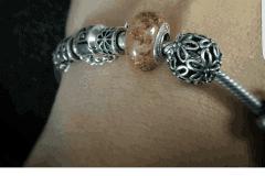 umbilical cord charm on client's Pandora bracelet