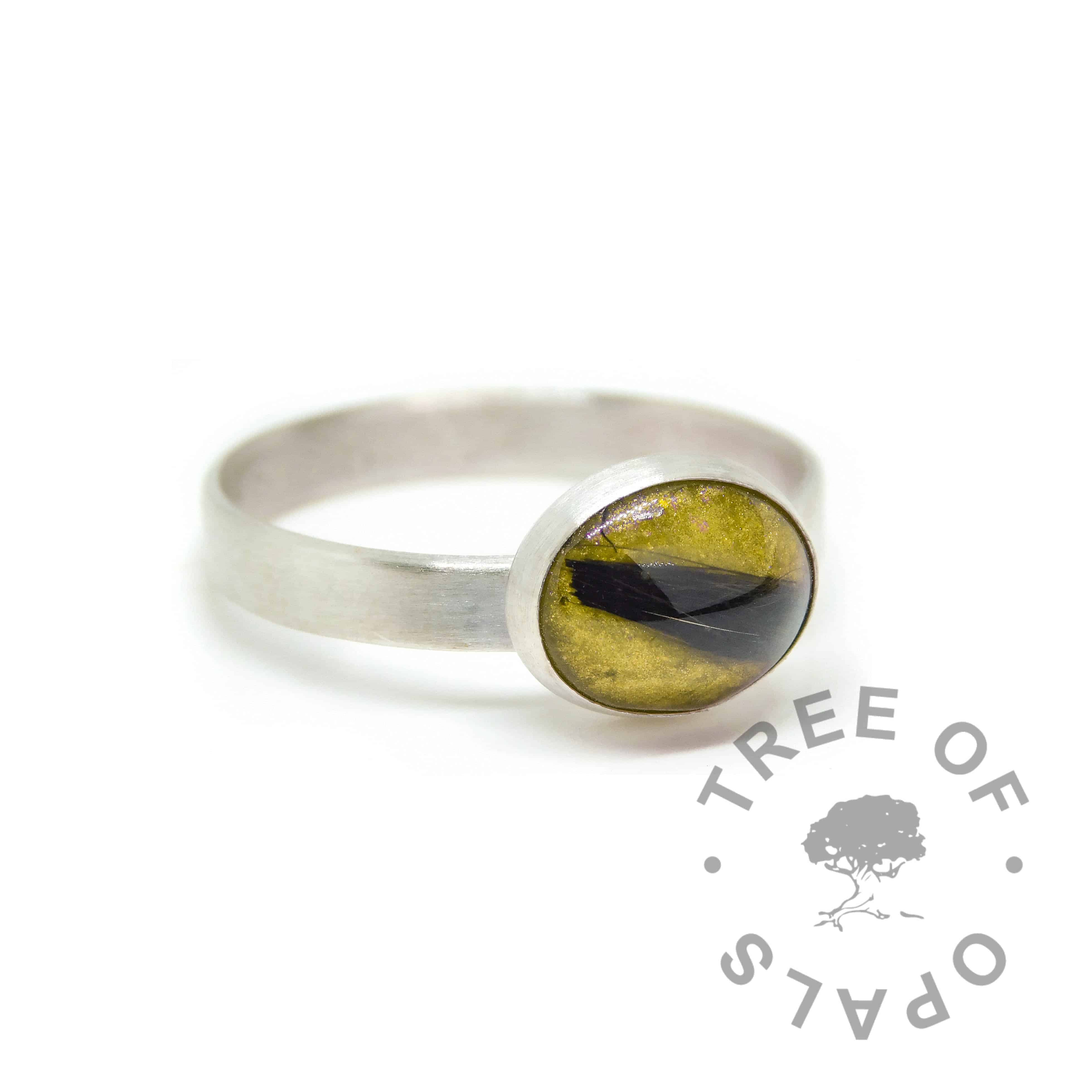 Daffodil yellow lock of hair ring on brushed wire band. Solid sterling EcoSilver handmade ring. 10x8mm bezel cup rubbed over the cabochon for security.