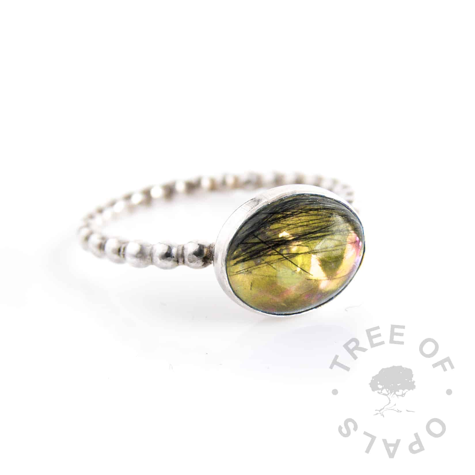 lock of hair ring with yellow opalescent flakes background on a bubble wire solid silver band and 10x8mm oval cabochon
