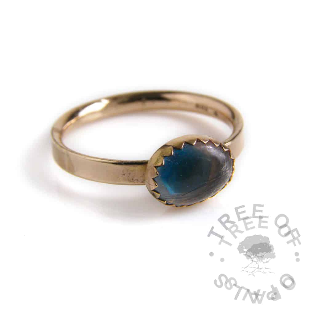 solid 14ct yellow gold lock of hair ring with white shimmer and blue topaz December birthstone