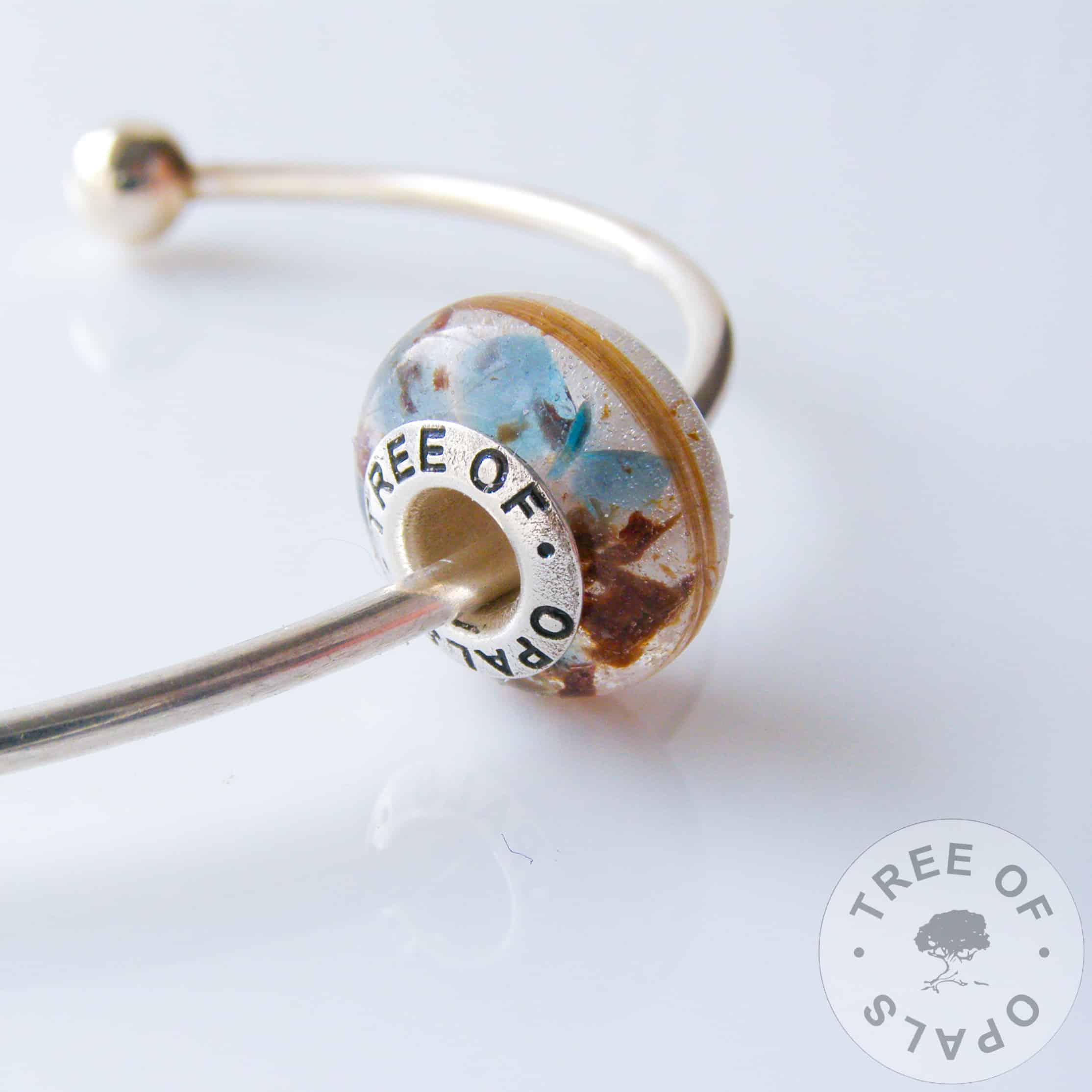 hair and umbilical cord charm bead with blue topaz december birthstone with solid Sterling silver Tree of Opals core, clear resin