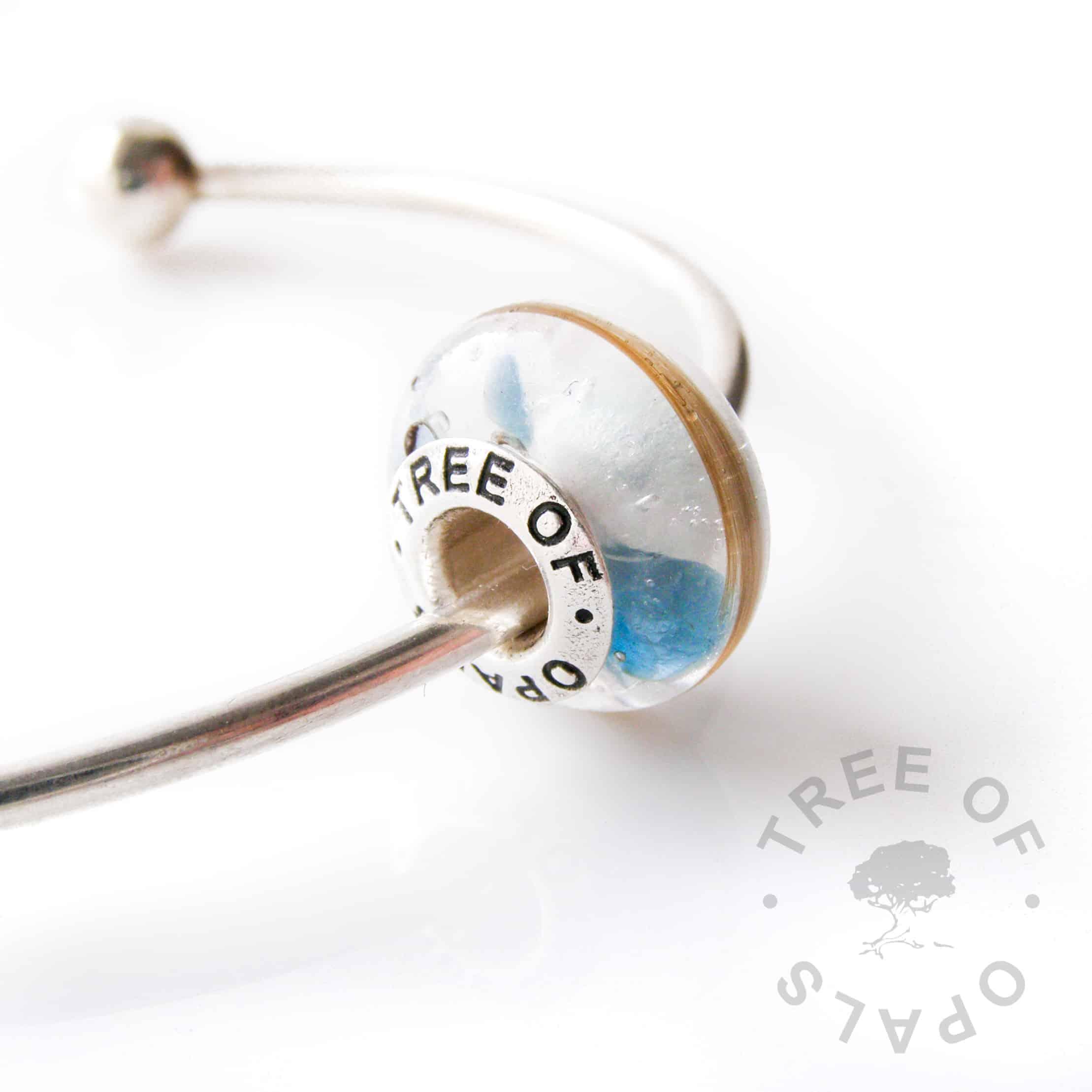 lock of hair charm blue topaz birthstone