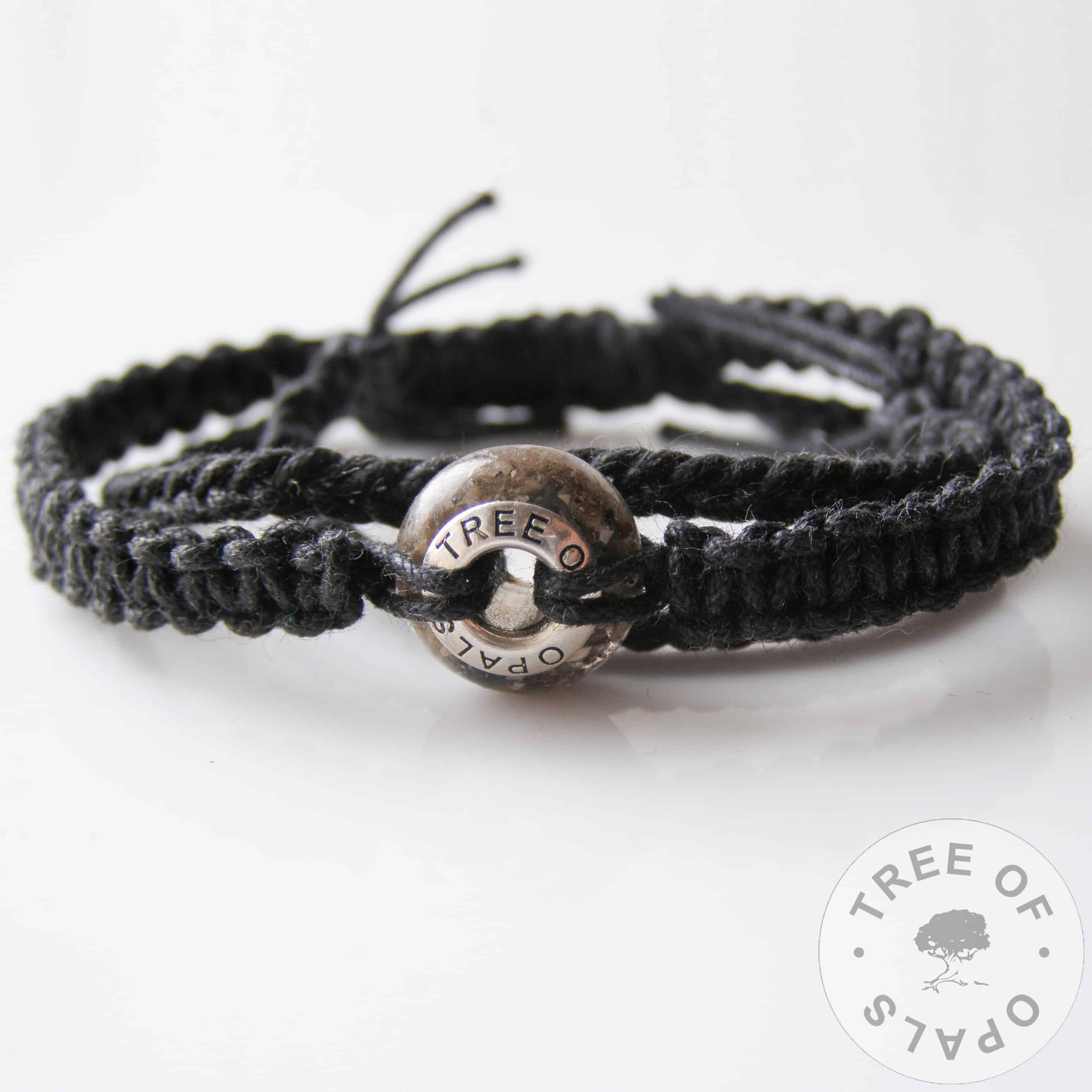 macrame surfer bracelet with cremation ash charm, black wax cord knotted adjustable men's unisex masculine bracelet shown with a cremation ash charm bead with blue topaz pro bono