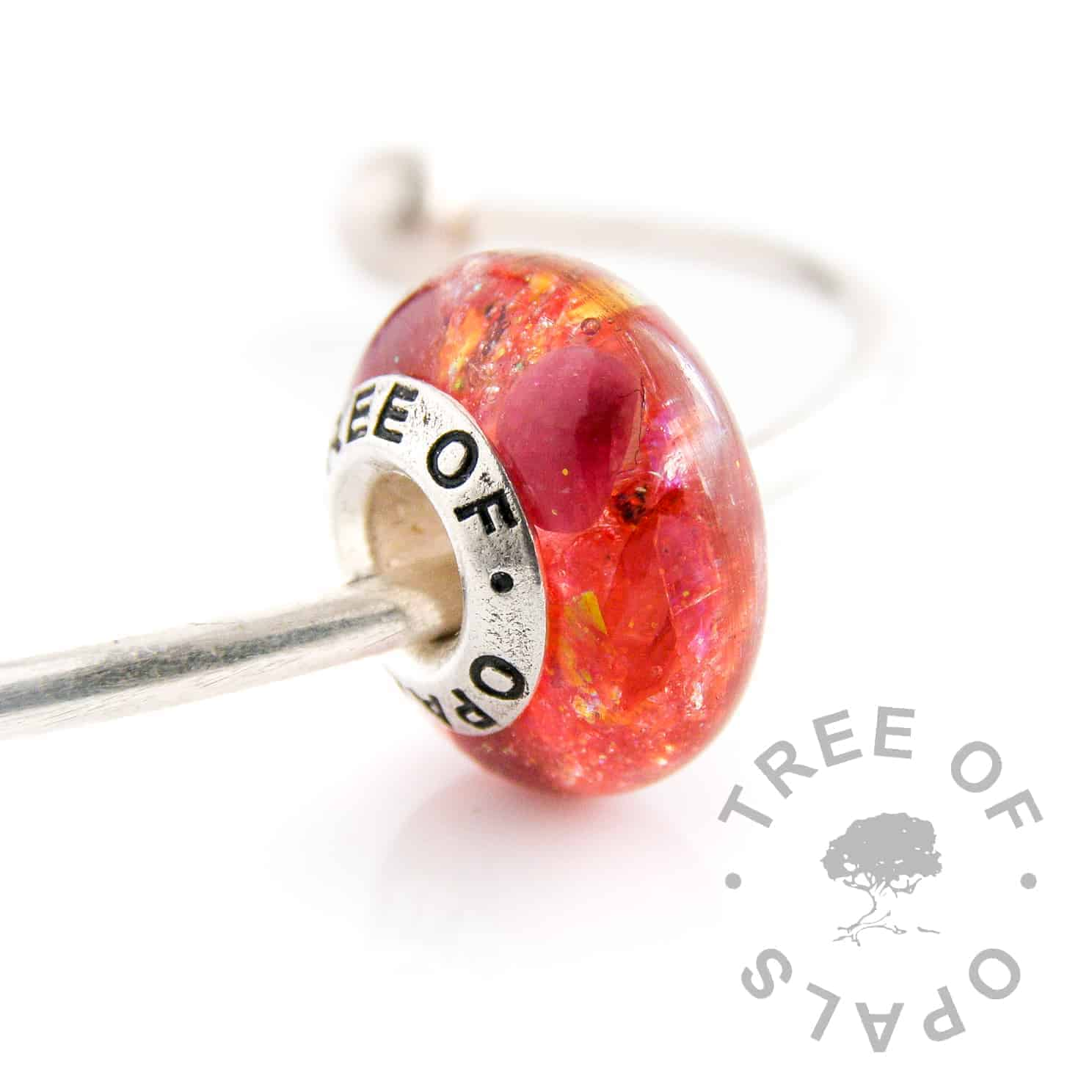 Lock of hair charm with ruby for July birthstone, rough natural gemstone. Red opalescent flakes and blonde naturally translucent hair