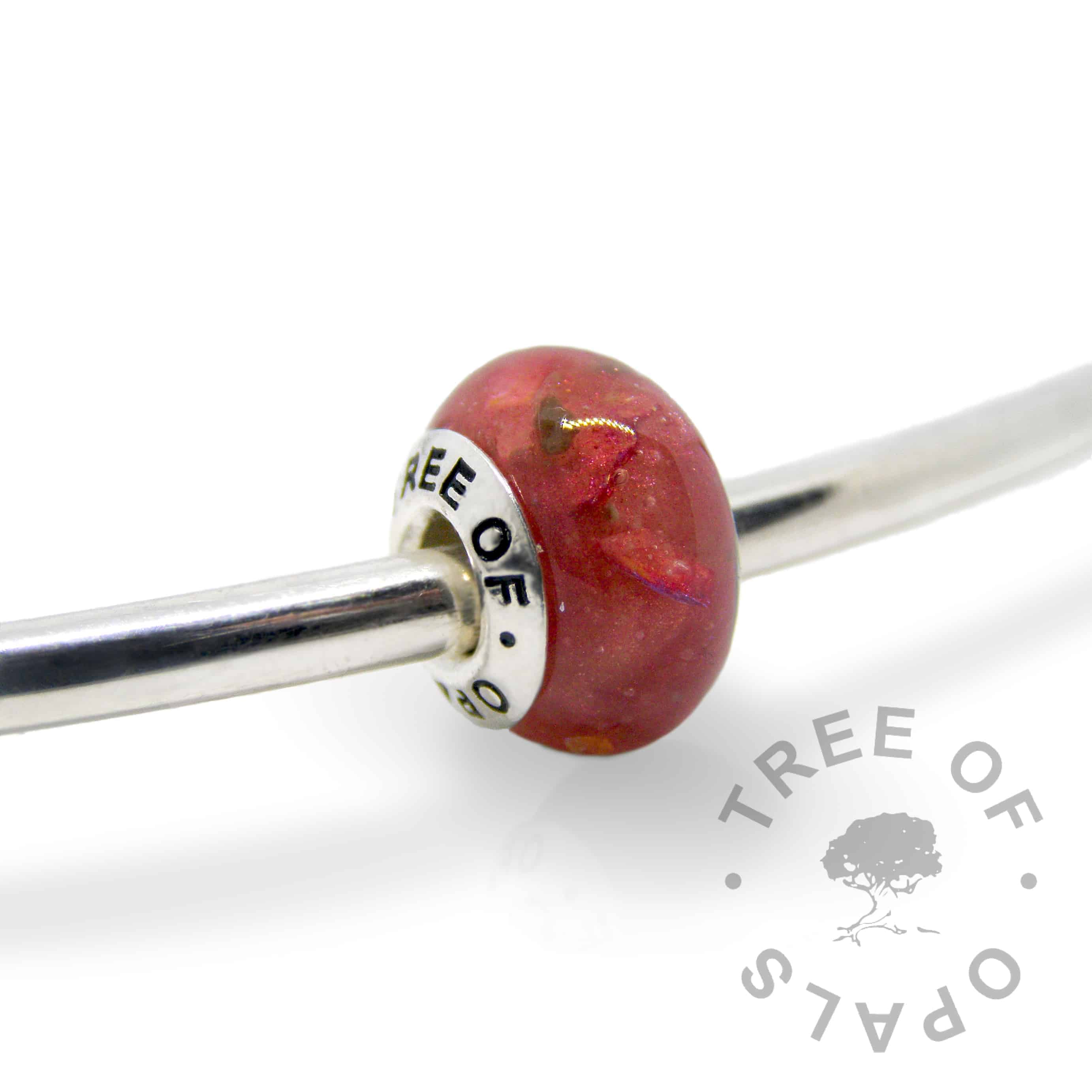 dragon's blood red cremation ash charm with solid sterling silver Tree of Opals core