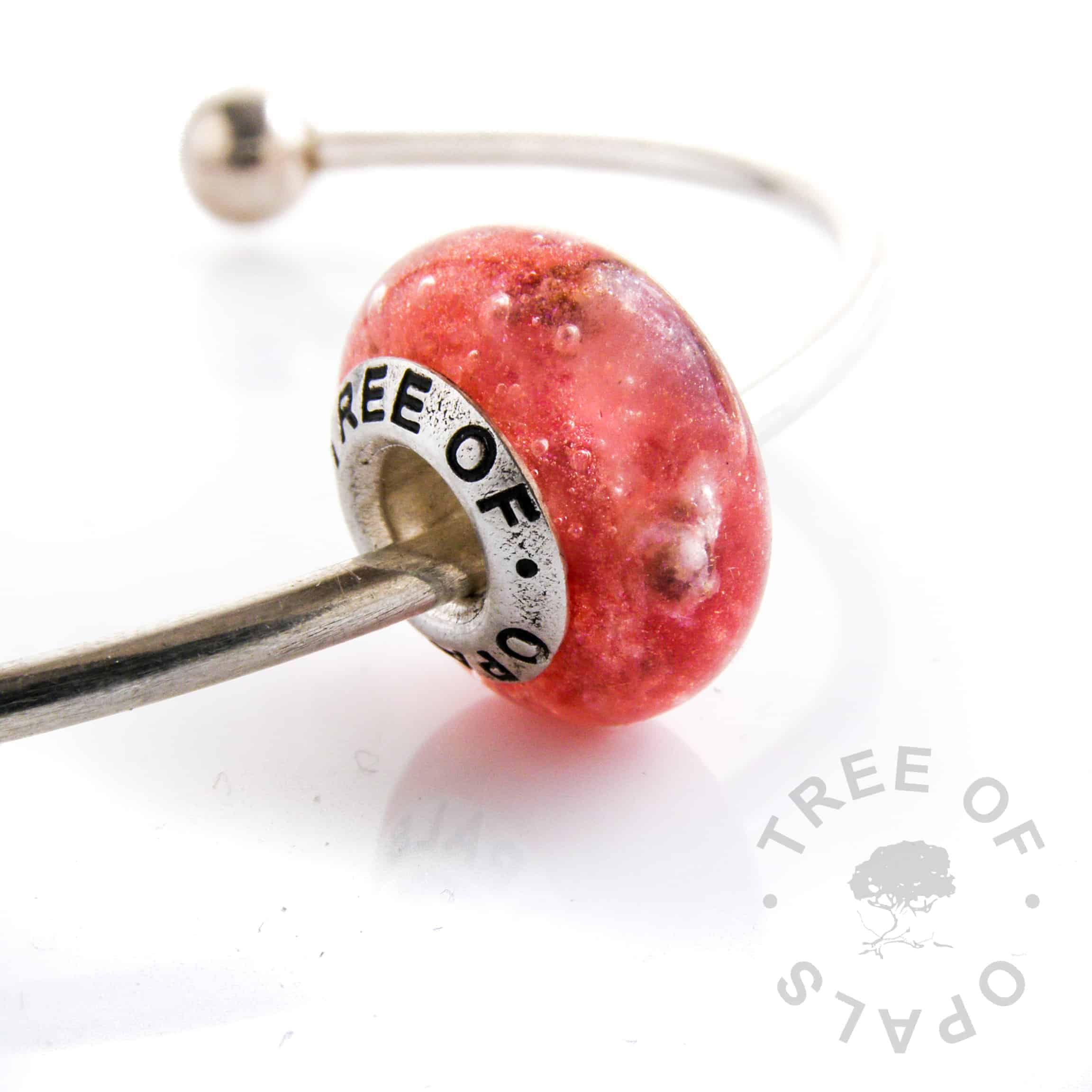 cremation ash charm bead with cherry red shimmer resin and ruby July birthstone