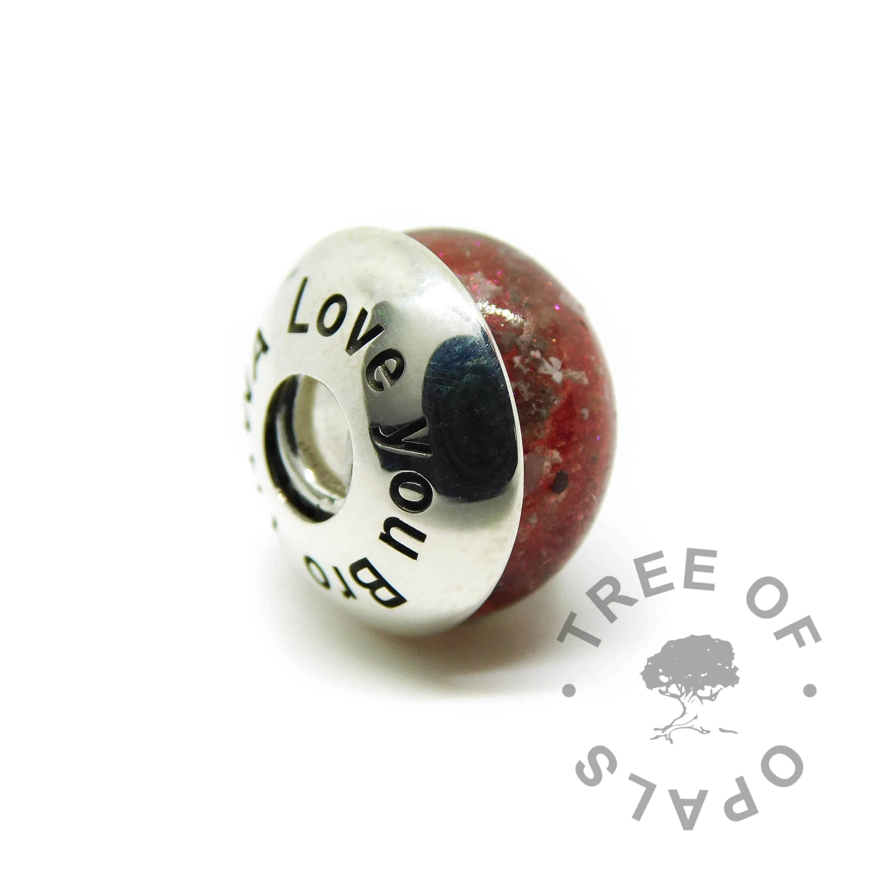 cremation ash charm dragon's blood red with Tree of Opals core and engraved charm washer