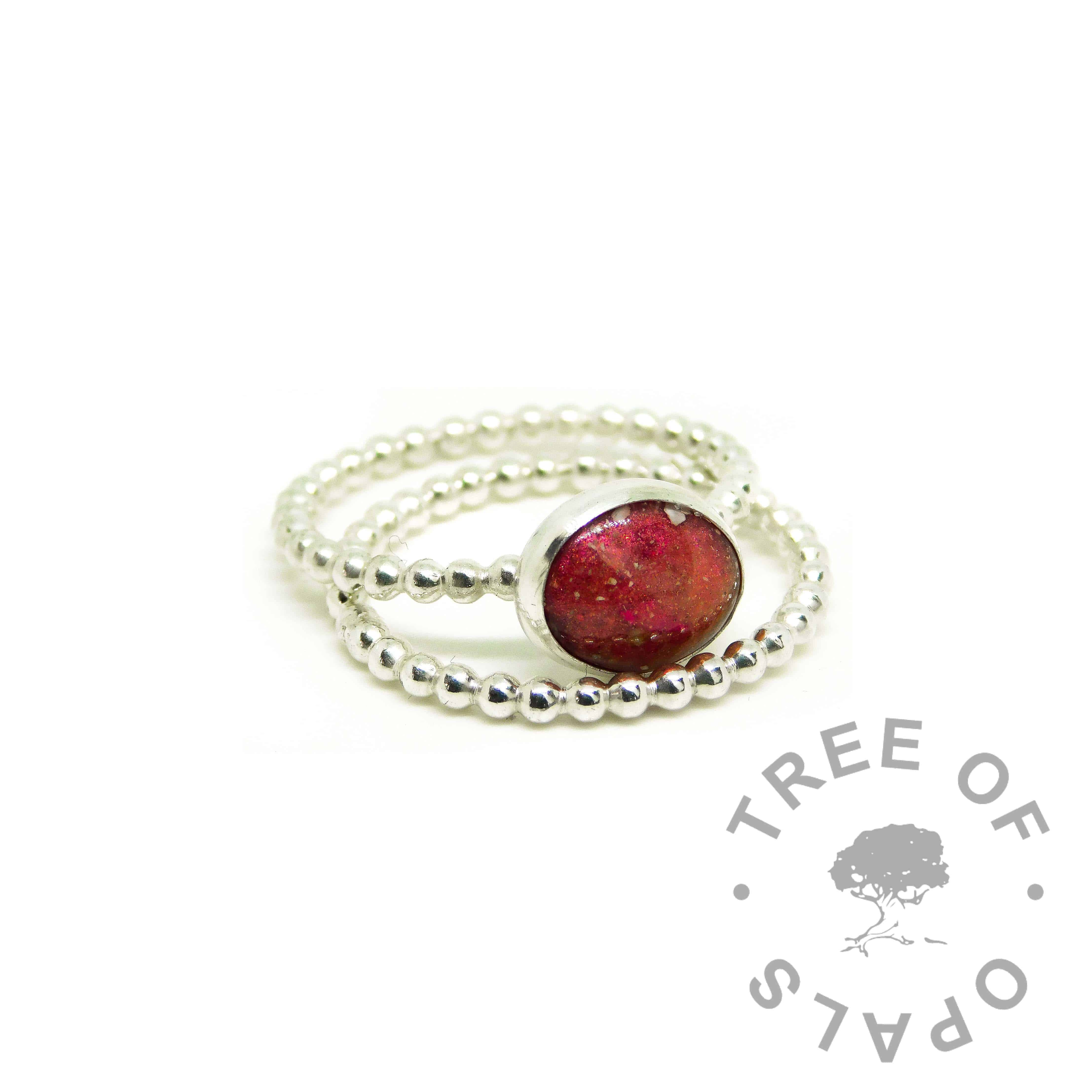red ashes ring, dragon's blood red resin sparkle mix, bubble wire Argentium silver band. Shown with a bubble wire slim stacking band
