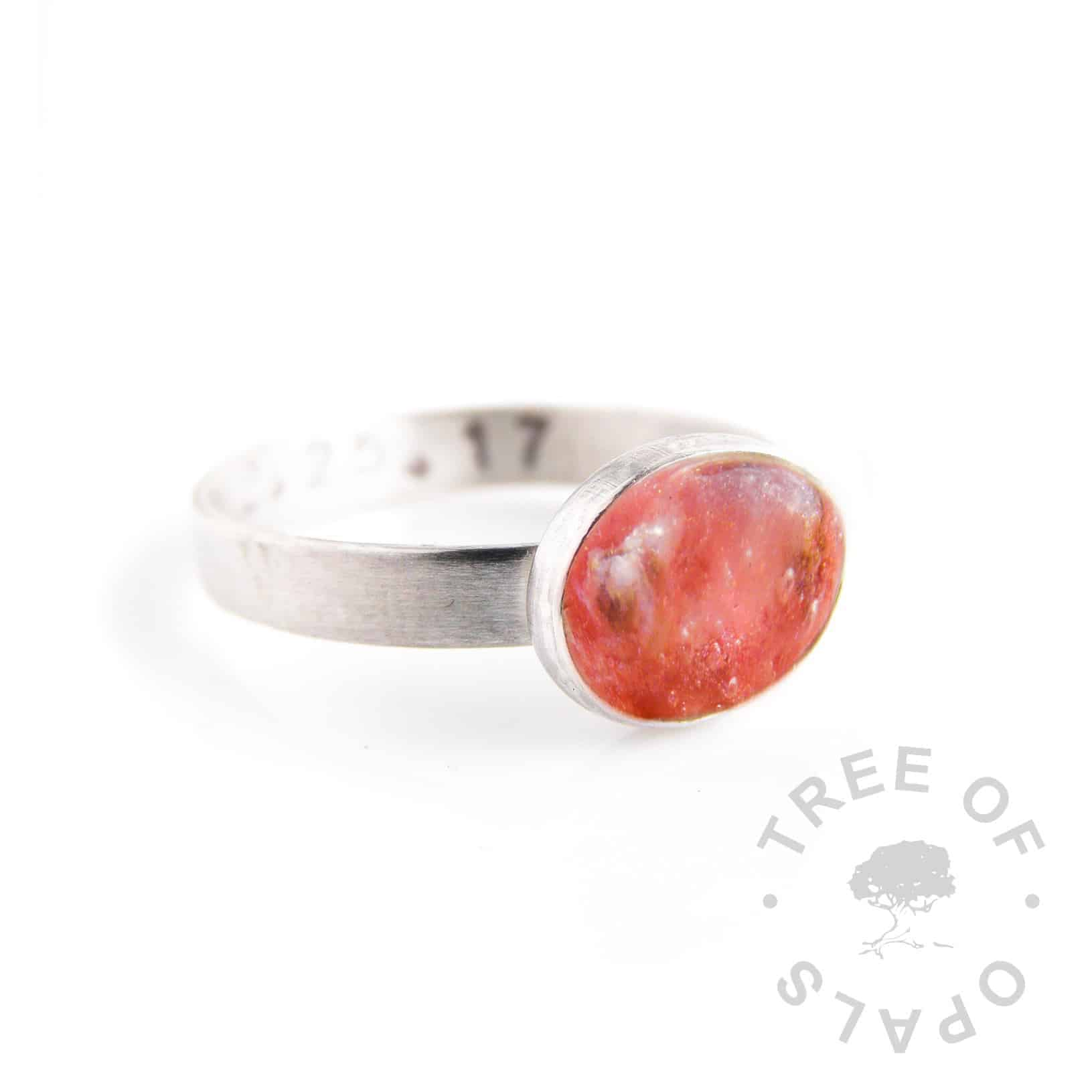 umbilical cord ring with coral shimmer resin and red garnet rough natural birthstone on a stamped band (mockup)