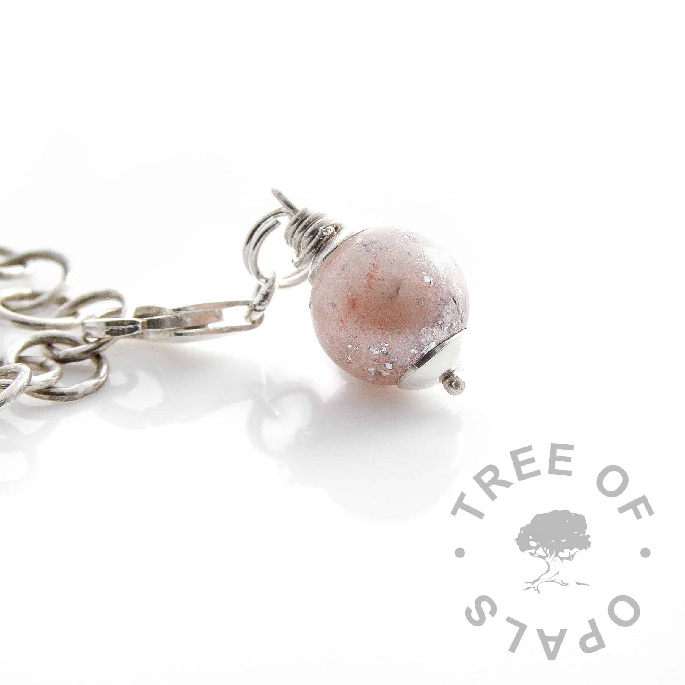breastmilk pearl dangle charm with punch pink shimmer and subtle silver leaf, hand wire wrapped with a lobster claw attachment. Perfect for Thomas Sabo style bracelets