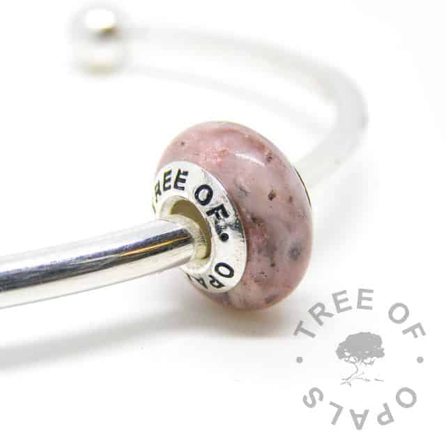 breastmilk and cremation ashes charm bead with lemonade pink shimmer powder