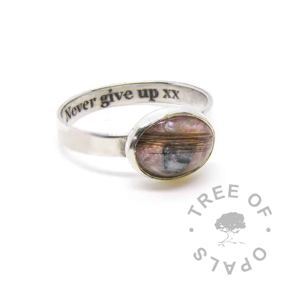 "laser engraved inside lock of hair ring with 10x8mm cabochon ""stone"" with hair, fairy pink sparkles and blue topaz December birthstone on a brushed 3mm wide solid sterling silver band"