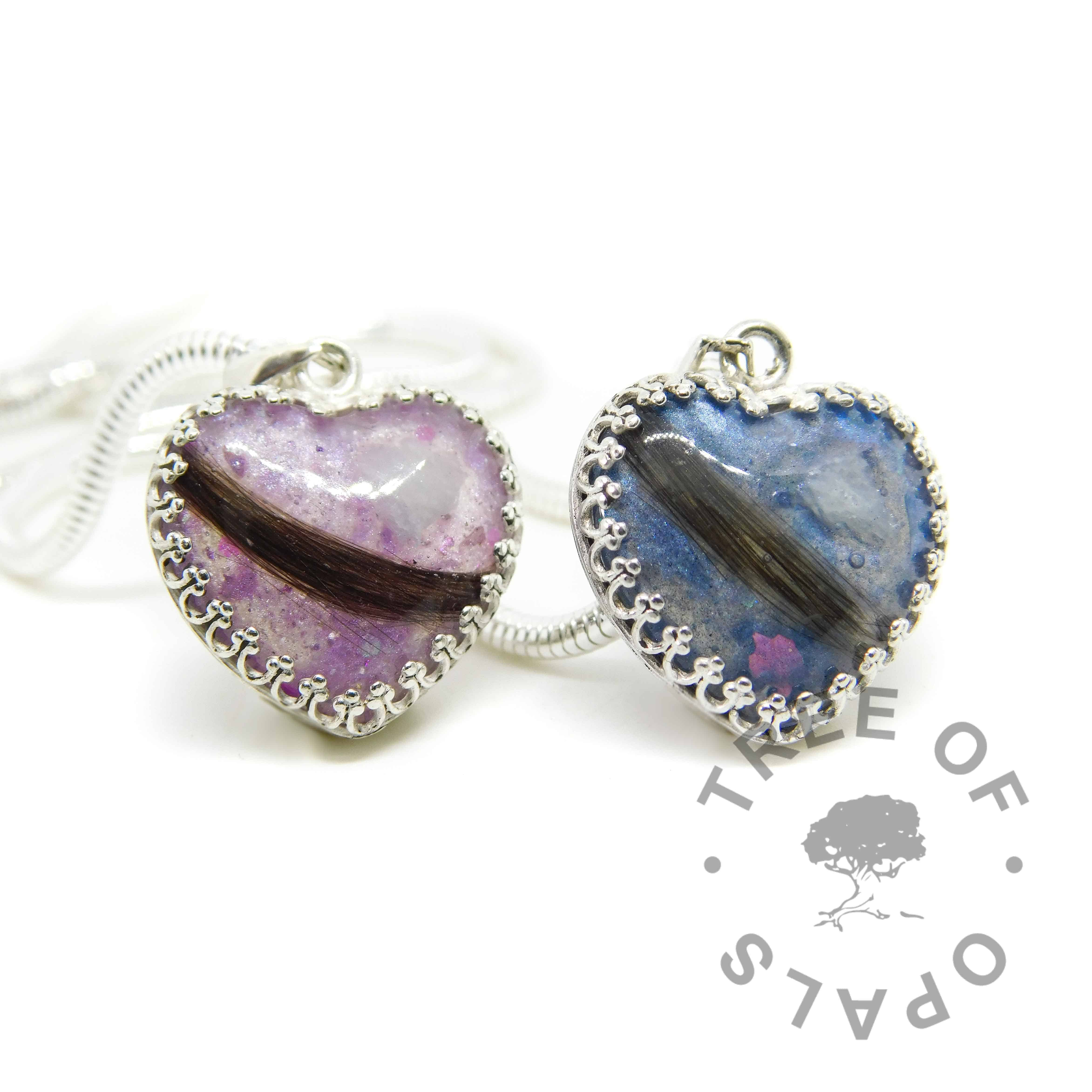 lock of hair heart necklaces with aquamarine March birthstone, Aegean blue and orchid purple resin sparkle mixes. 18mm heart with solid sterling silver crown point setting. Shown with wide snake chain upgrade. Copyright watermarked image