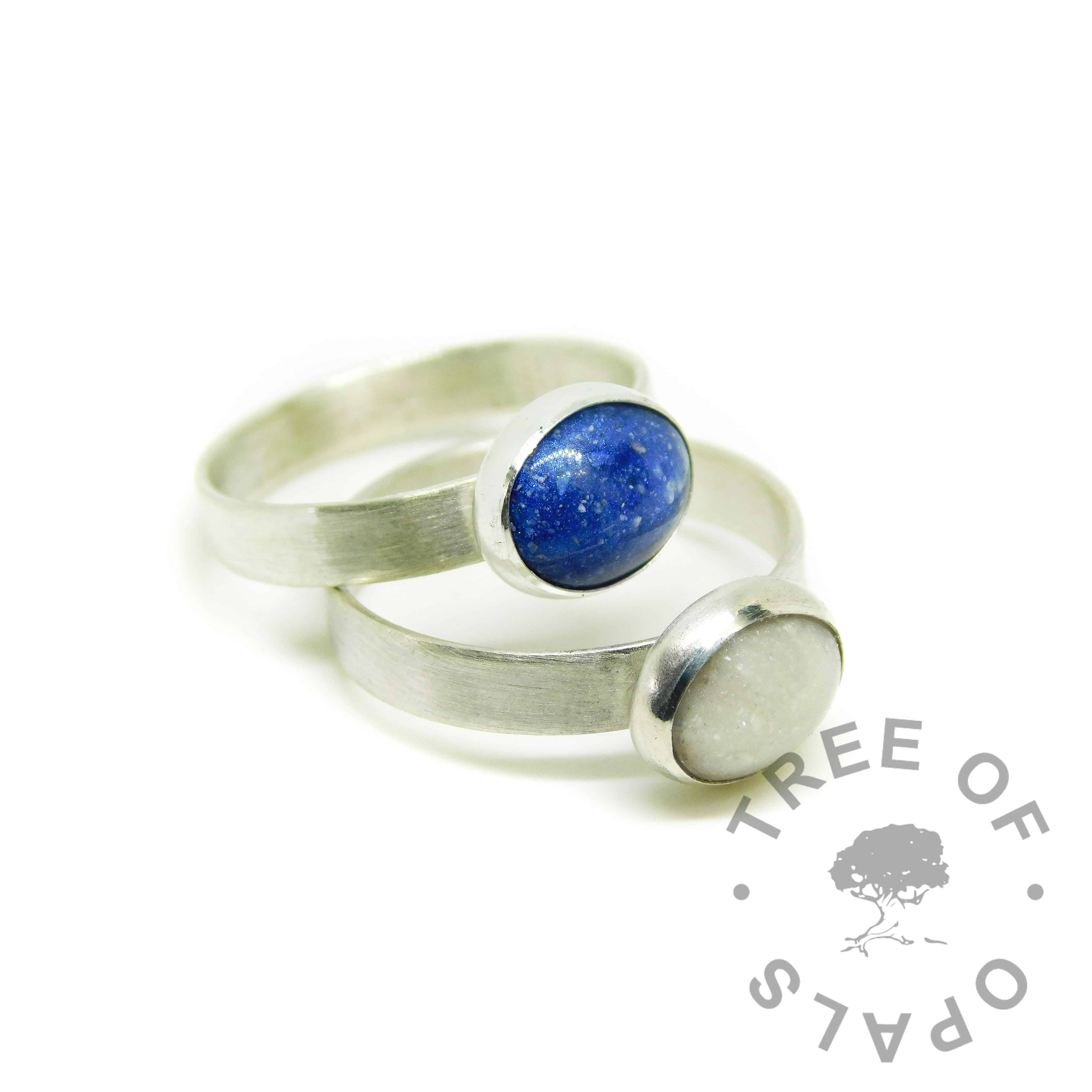 Cremation ash rings with Aegean blue and unicorn white resin sparkle mixes. Brushed band ring solid sterling EcoSilver