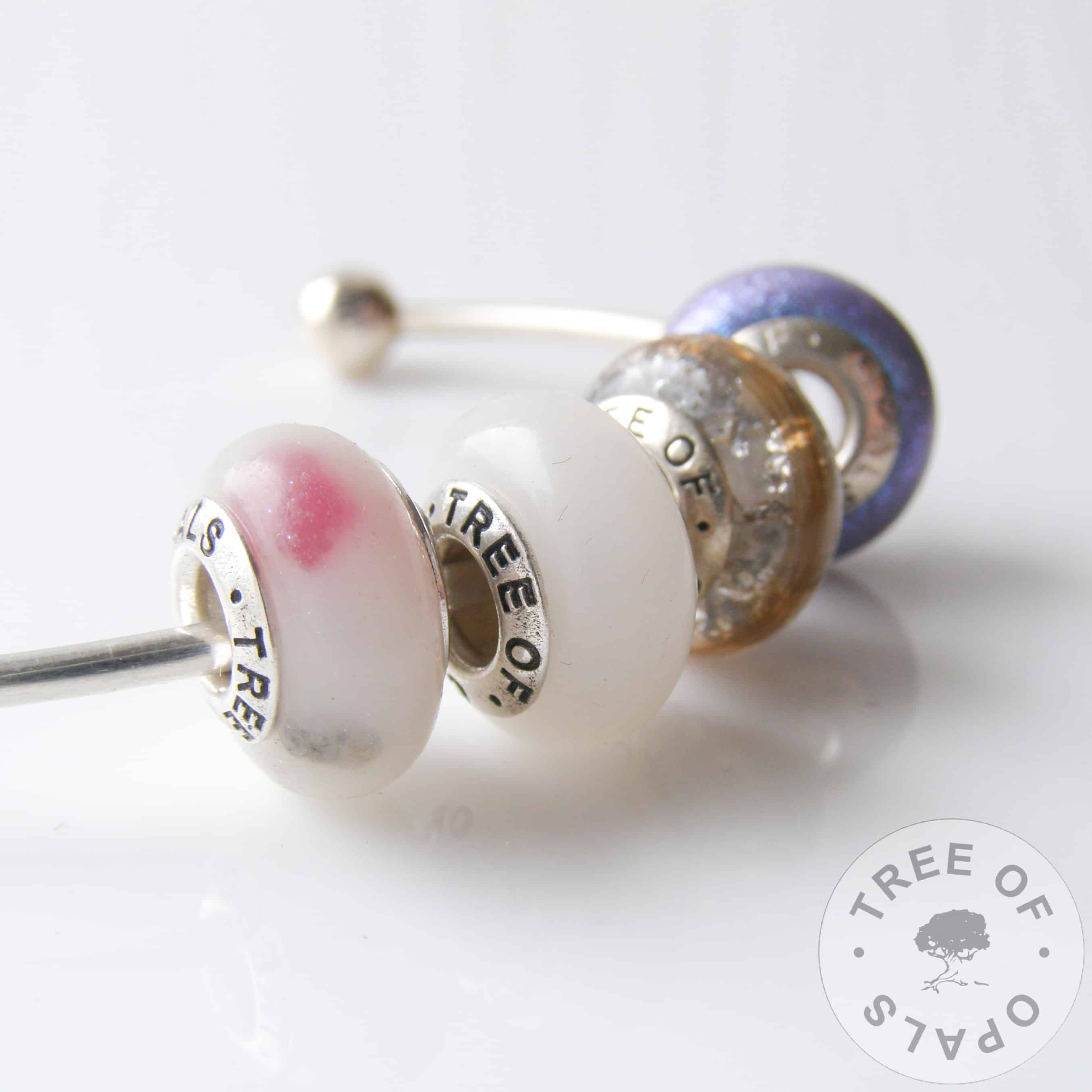 example of a charm bead quad for a Trollbeads or Pandora bracelet