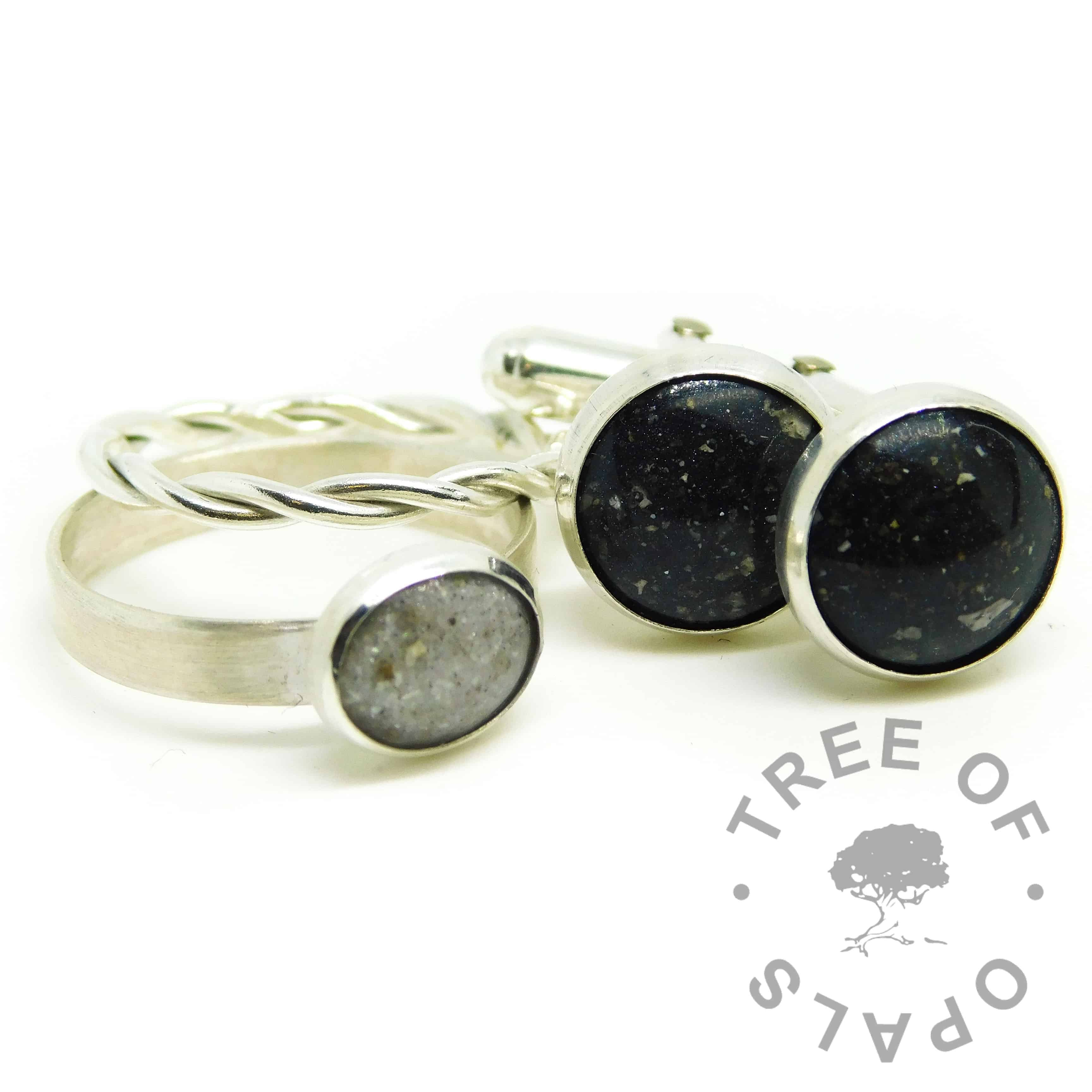 cremation ashes cufflinks with Vampire Black Resin Sparkle Mix and a unicorn white ring on brushed band shown with a twisted band slim stacking ring