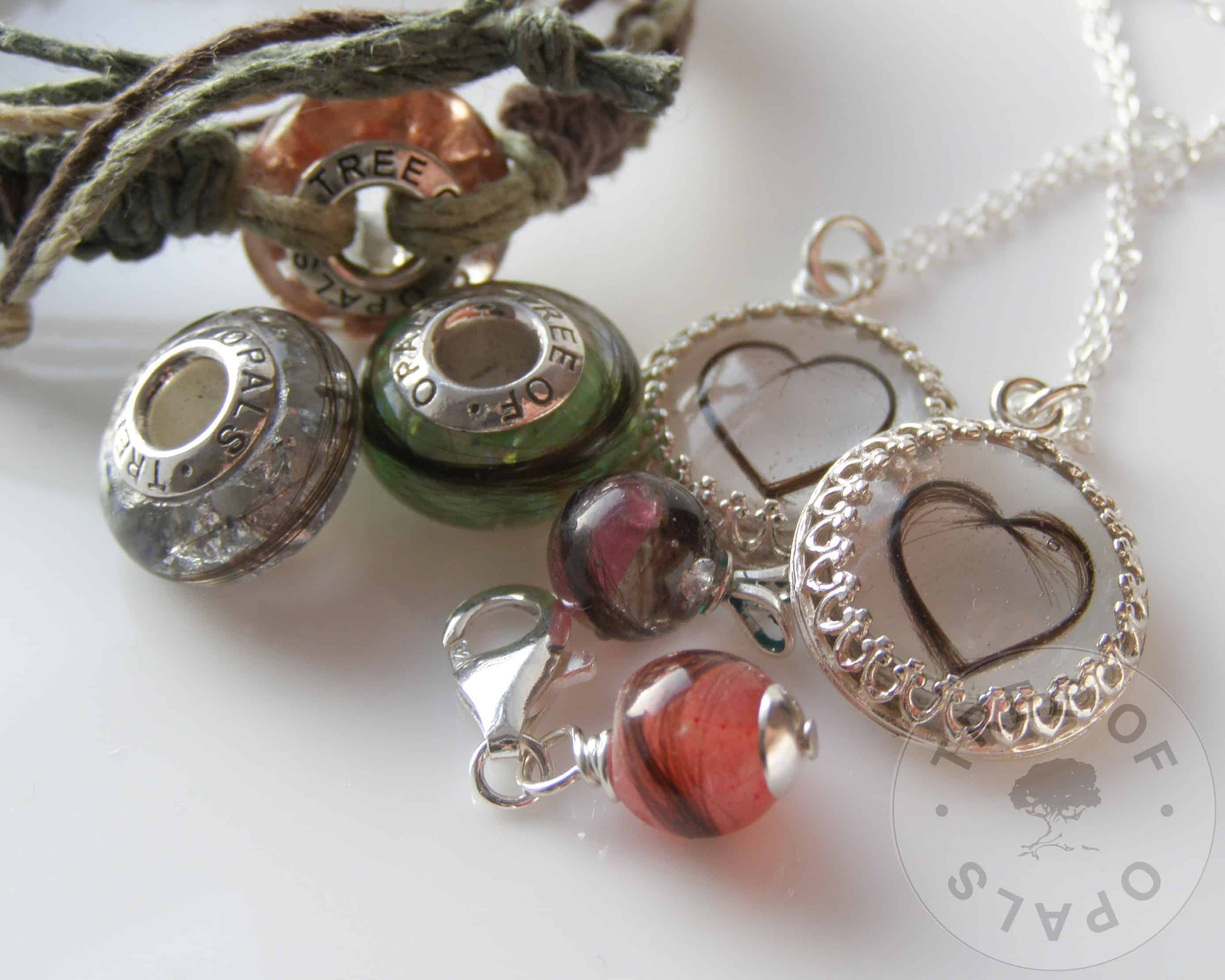 lock of hair family set with three charm beads, two necklaces and two pearls