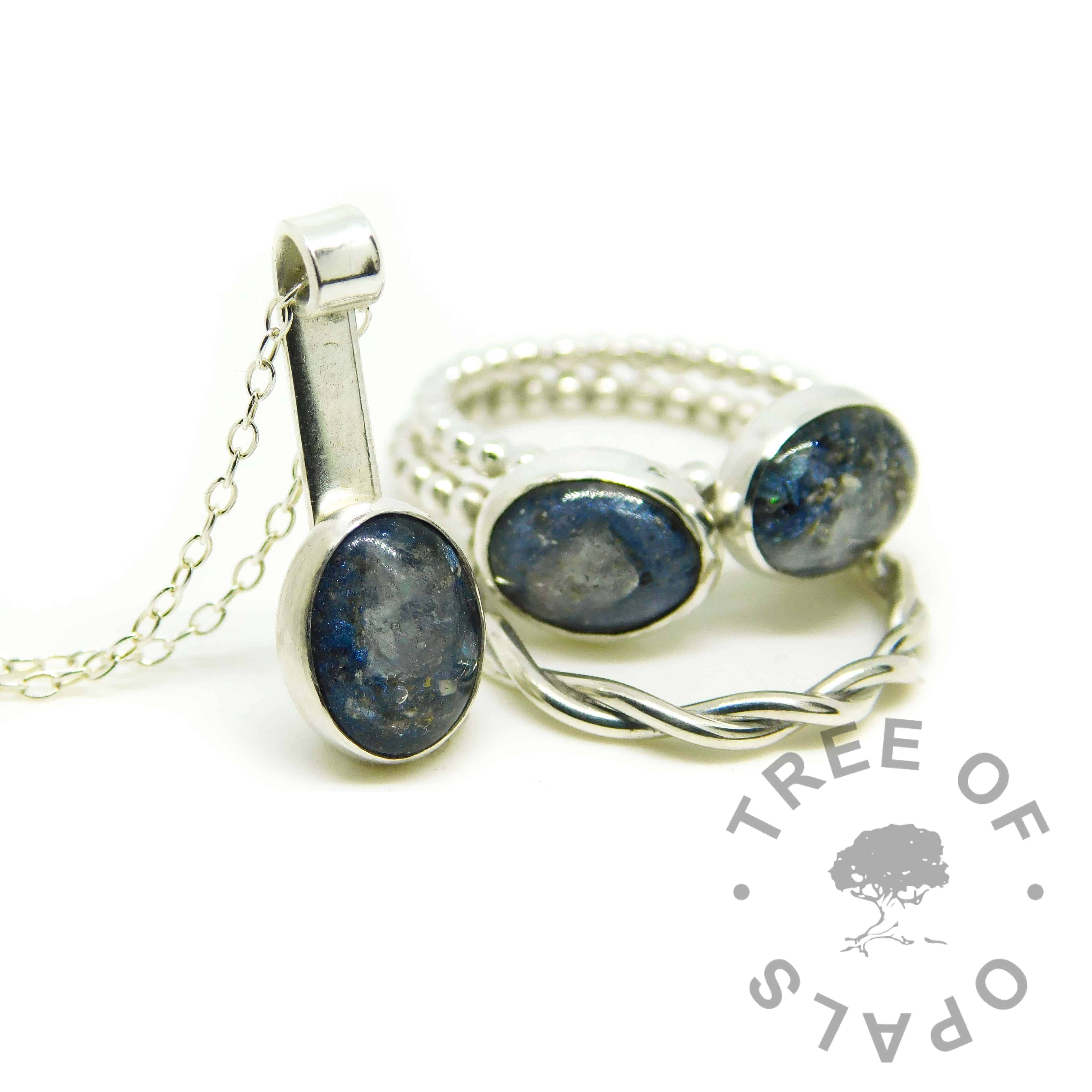 ash mystery piece with Aegean blue resin sparkle mix and moonstone June birthstone. Family order two rings, stacking ring and mystery piece