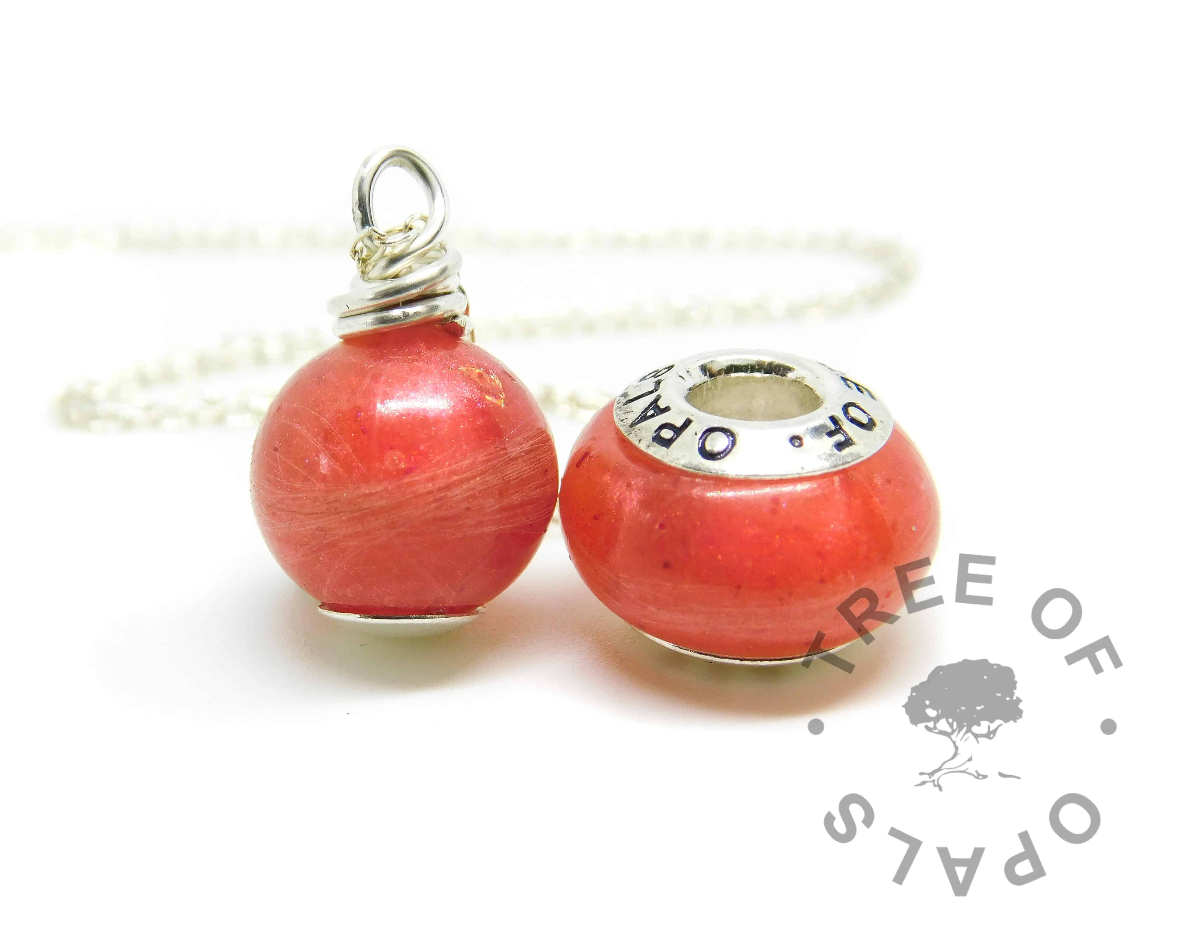 Lock of hair pearl and charm. Naturally white or very light blonde hair with dragon's blood red resin sparkle mix, no birthstones. Pearl set with solid sterling handmade headpin and shown with the standard necklace chain, charm set with Tree of Opals core. Watermarked copyright image by Tree of Opals