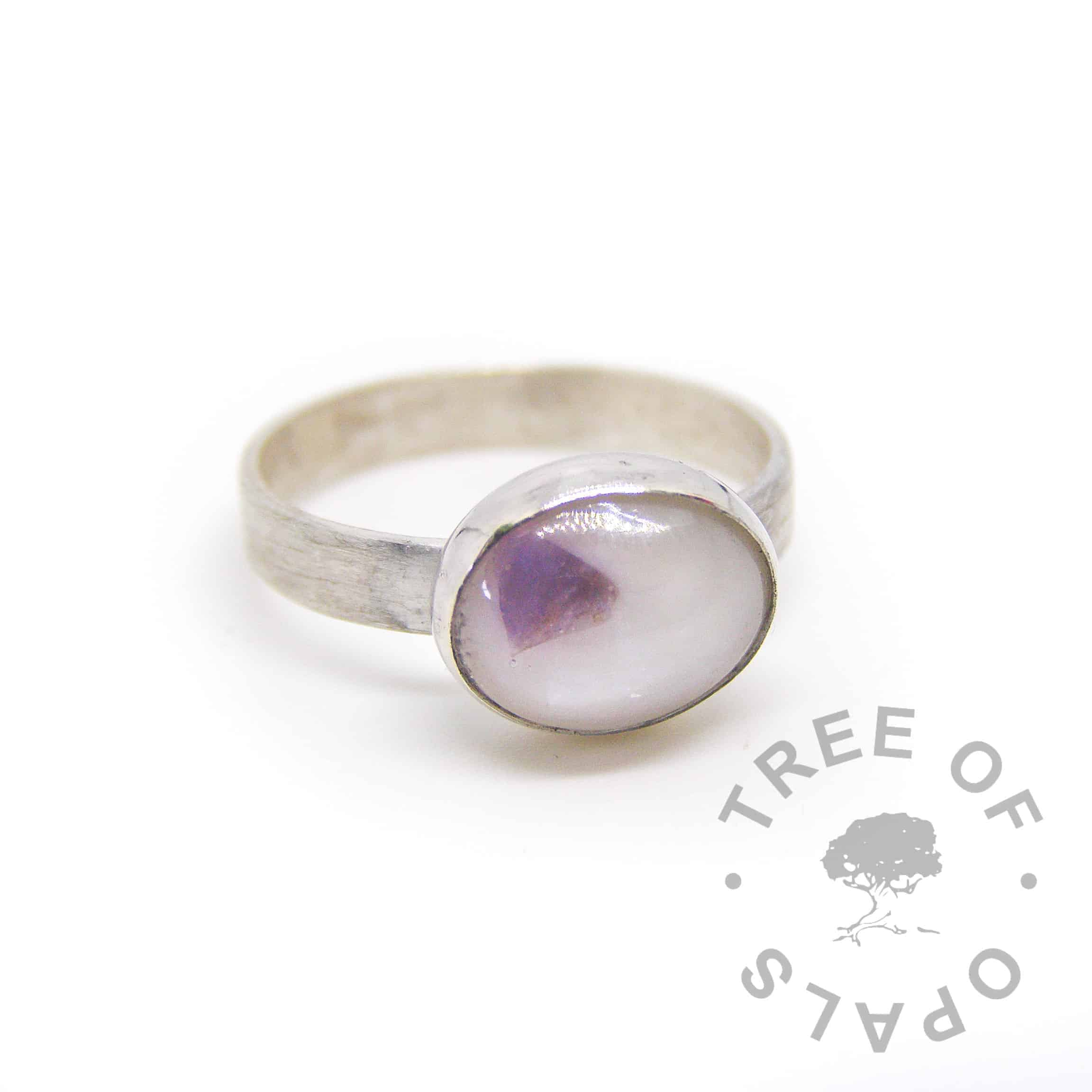 breastmilk ring with February birthstone amethyst. On brushed band