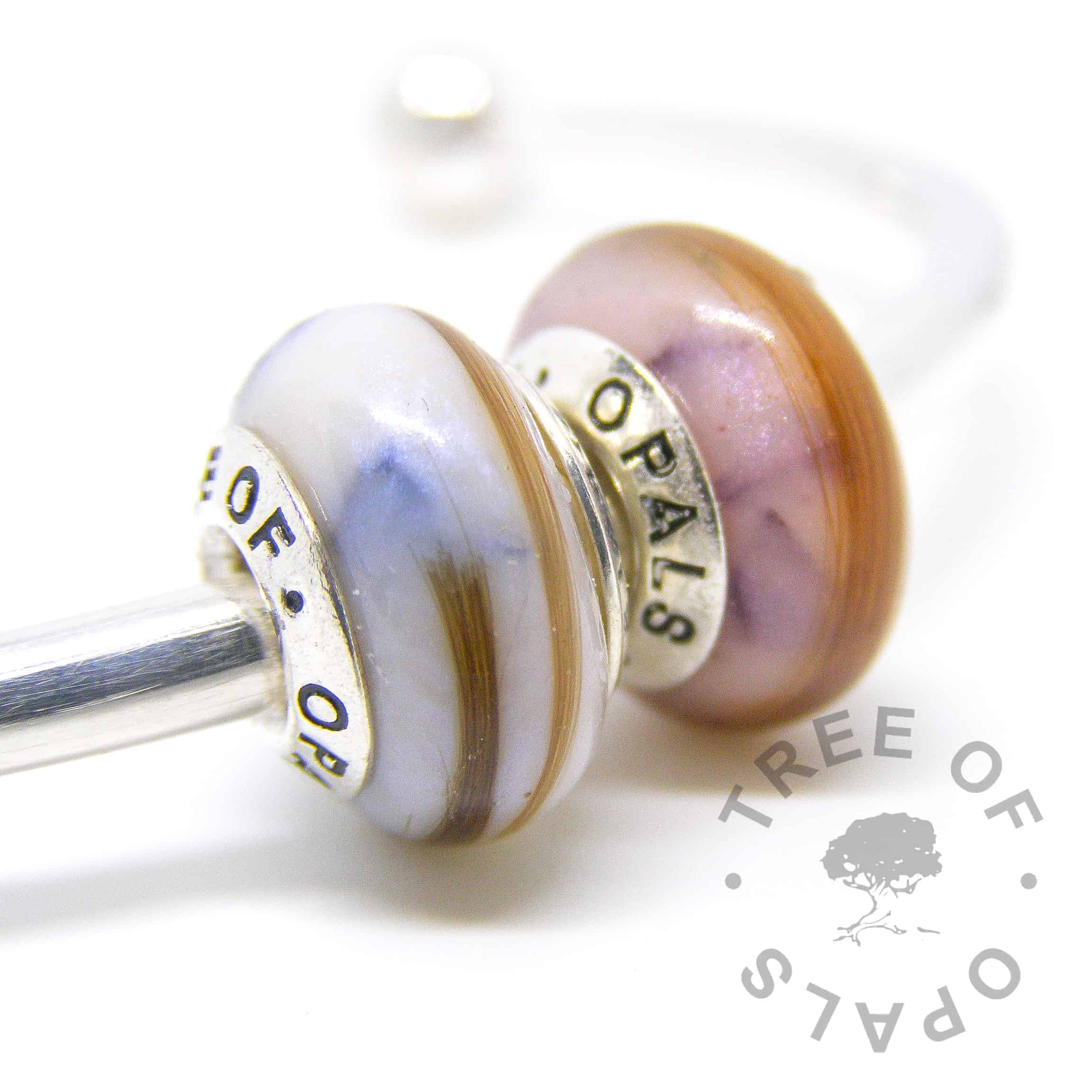 breastmilk and hair duo with shimmers and birthstones sapphire and amethyst and breast milk in resin with a solid sterling silver Tree of Opals branded core, September birthstone and February birthstone