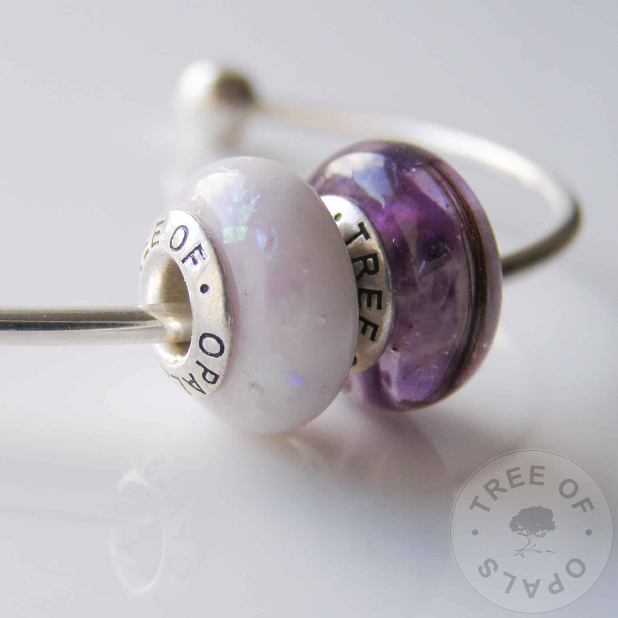 breastmilk and first curl charm bead duo - breast milk charm bead with purple opalescent flakes and lock of hair bead with genuine rough amethyst